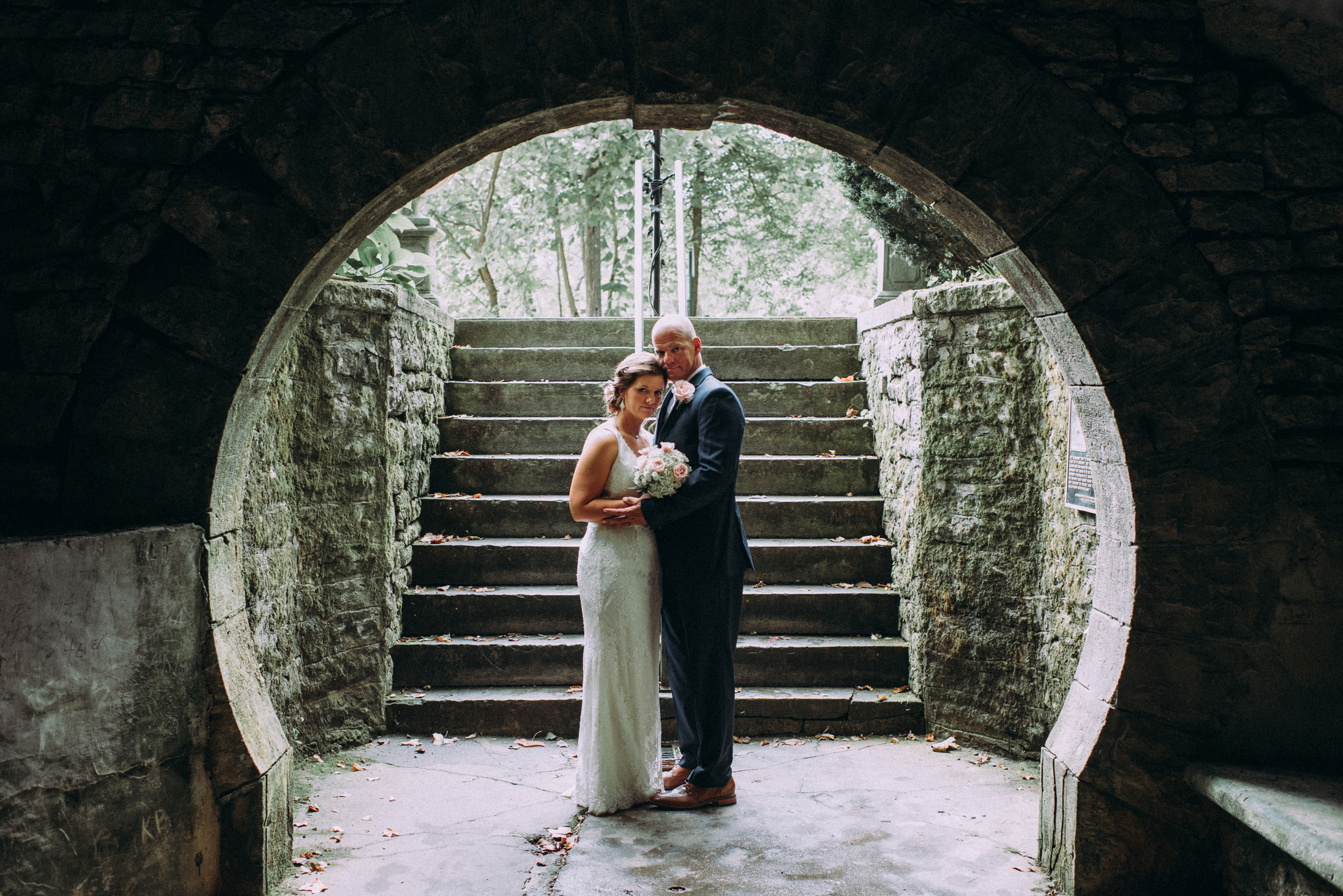 Bride and Groom inside grotto spring
