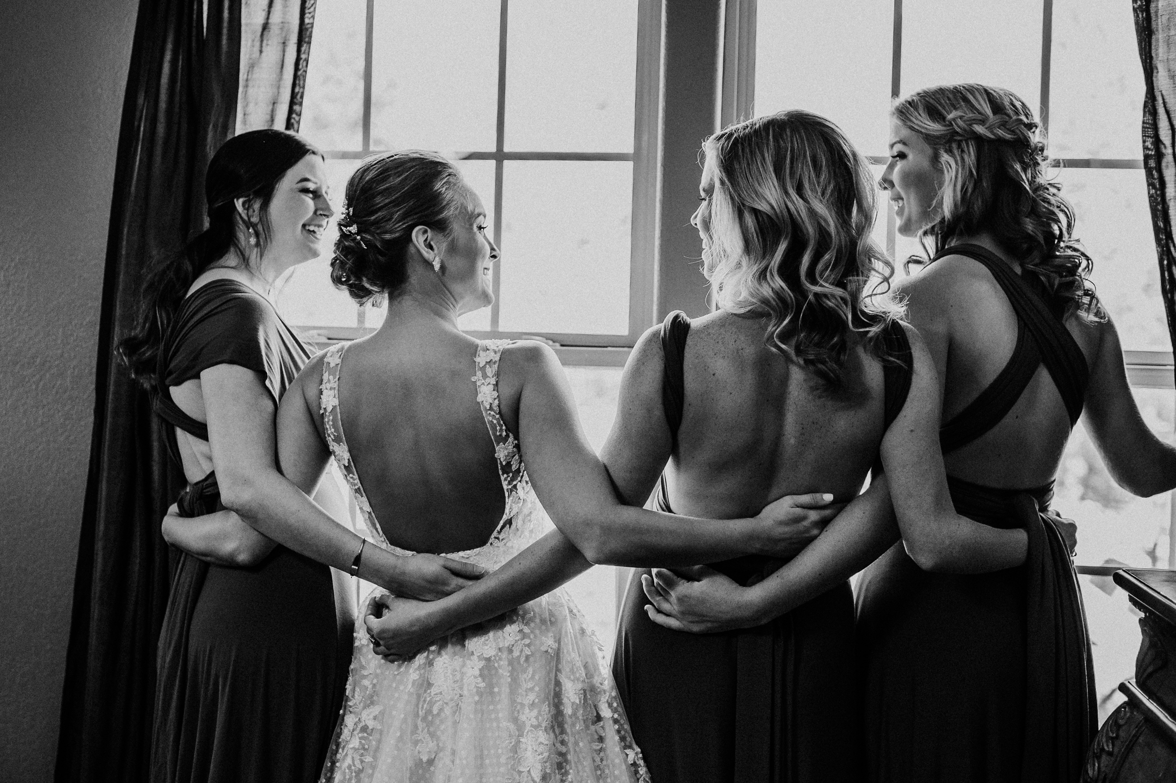 Bride and bridesmaids at window