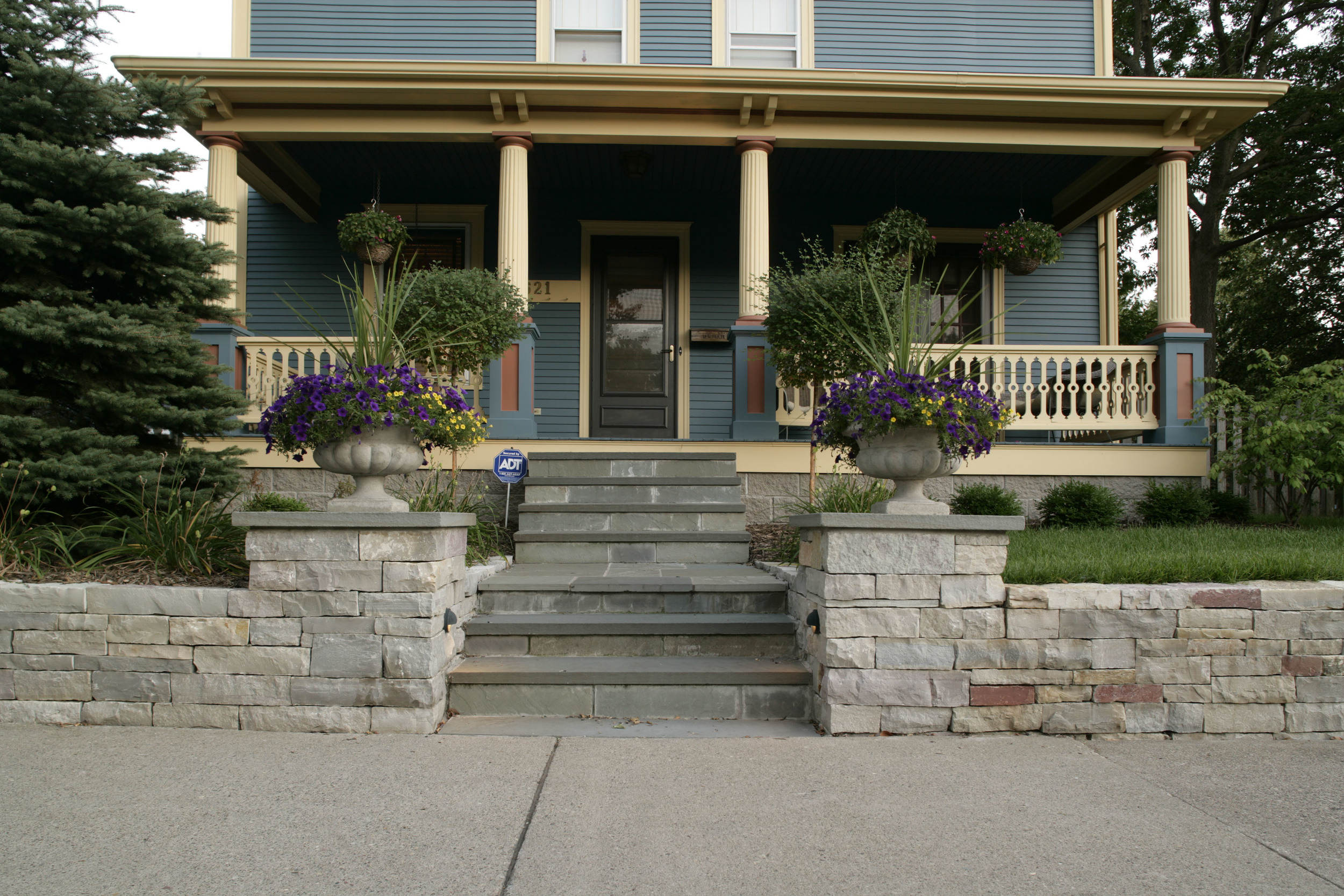 grand entrance with bluestone paving and limestone walls