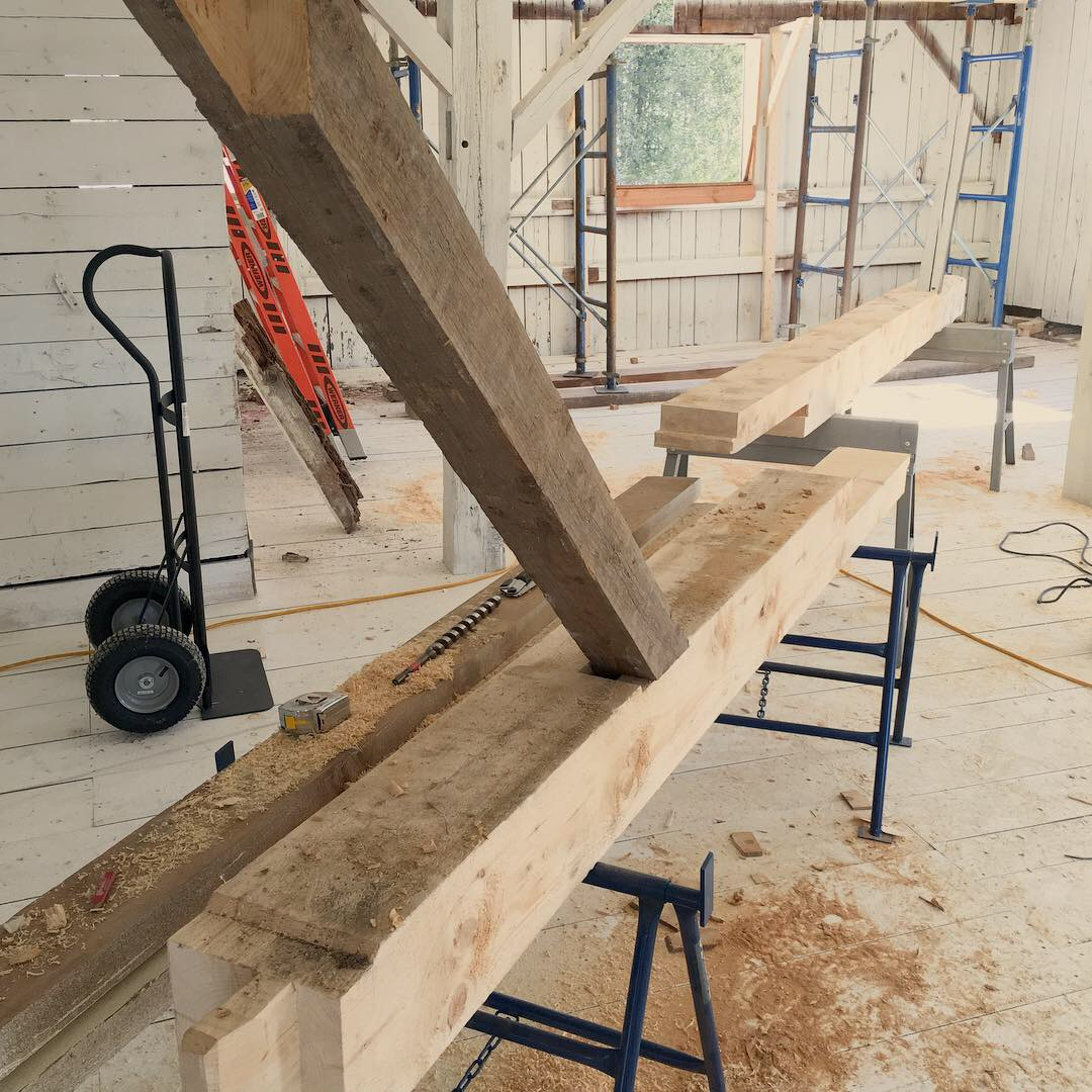 The undersized and failed timber was removed, and a replacement fabricated out of a larger dimension piece. Pictured above are the two halves of the replacement prior to installation, showing traditional joinery.