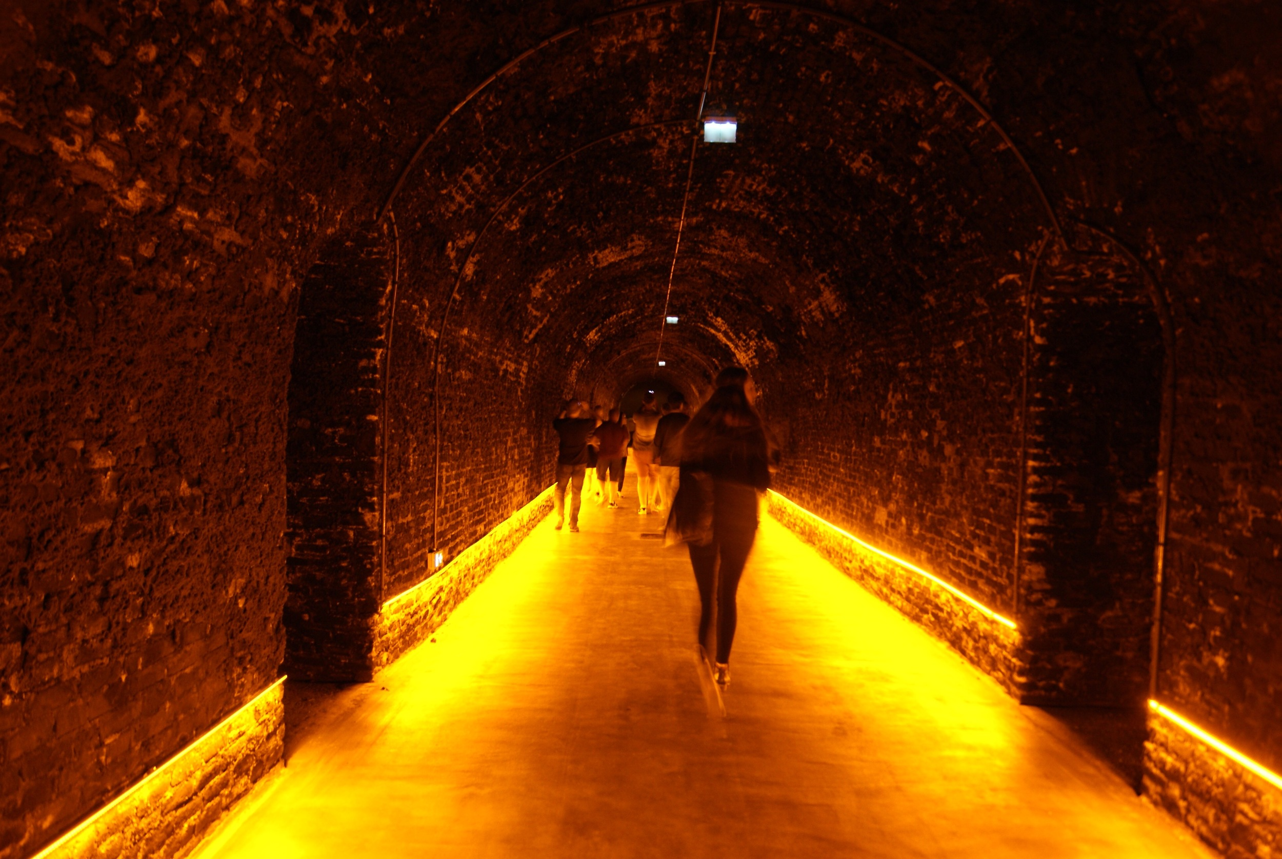 Walking in Lansons Caves...they use special light bulbs that do not create heat and gives an orange glow to photos.