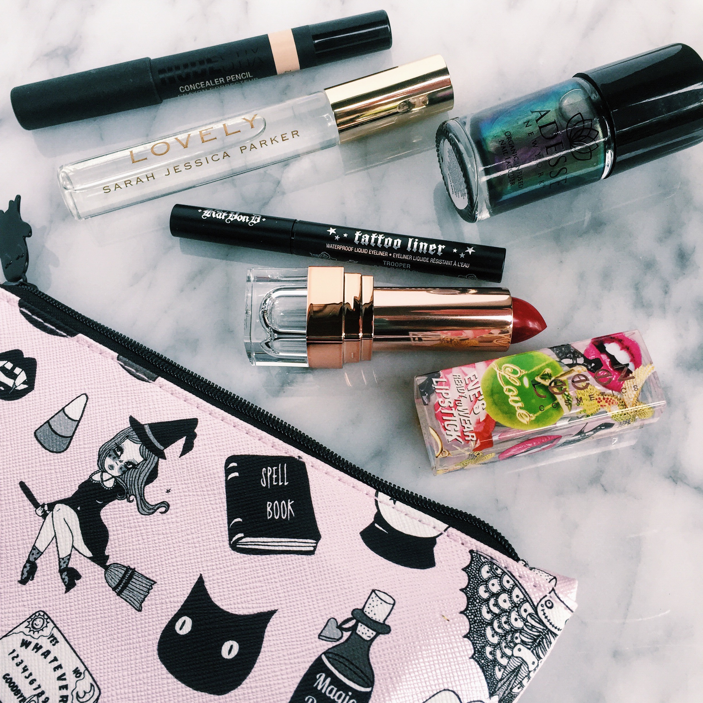One of our Past Glam Bag from Ipsy! Full-size lipstick, nail polish, perfume roller, concealer, and a half size eyeliner.