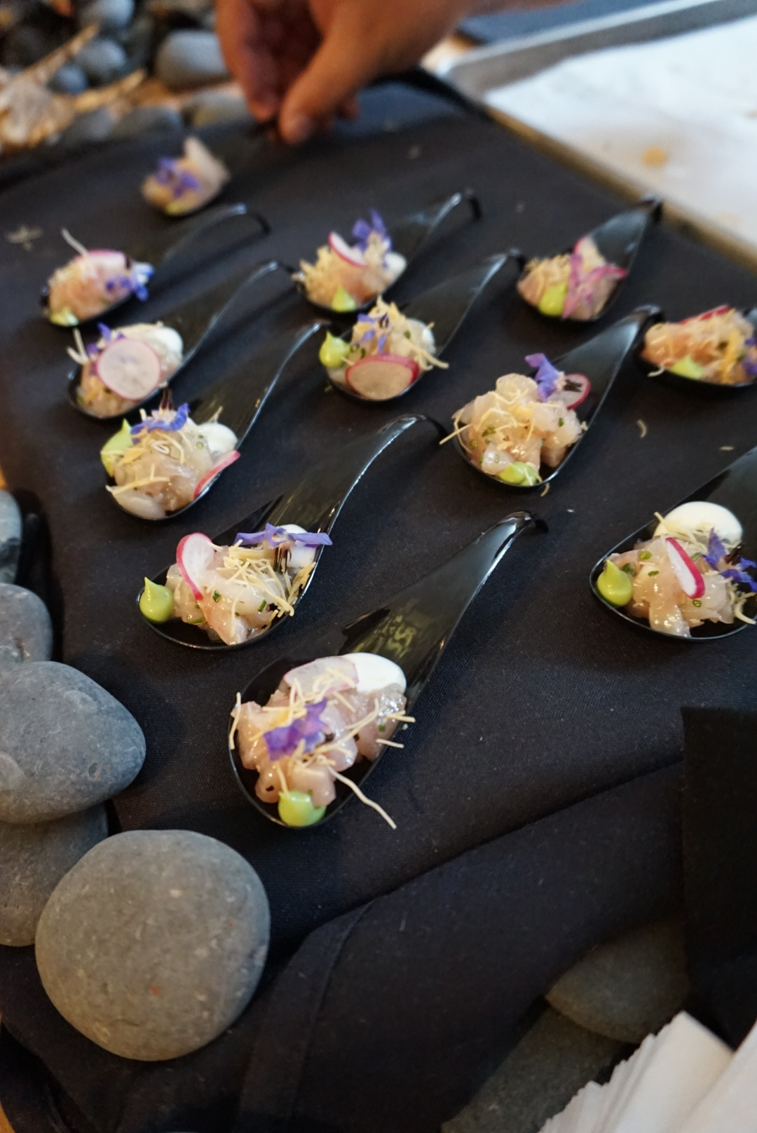 Kona kampachi tartar with shallots, chives, avacado puree, radish, lemon aioli and honey crumble.