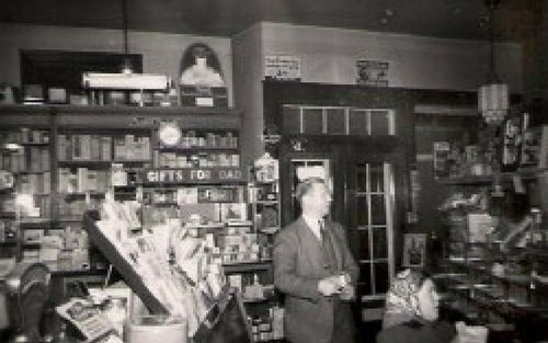 Aaron Newhard, in the pharmacy;  Photo Source