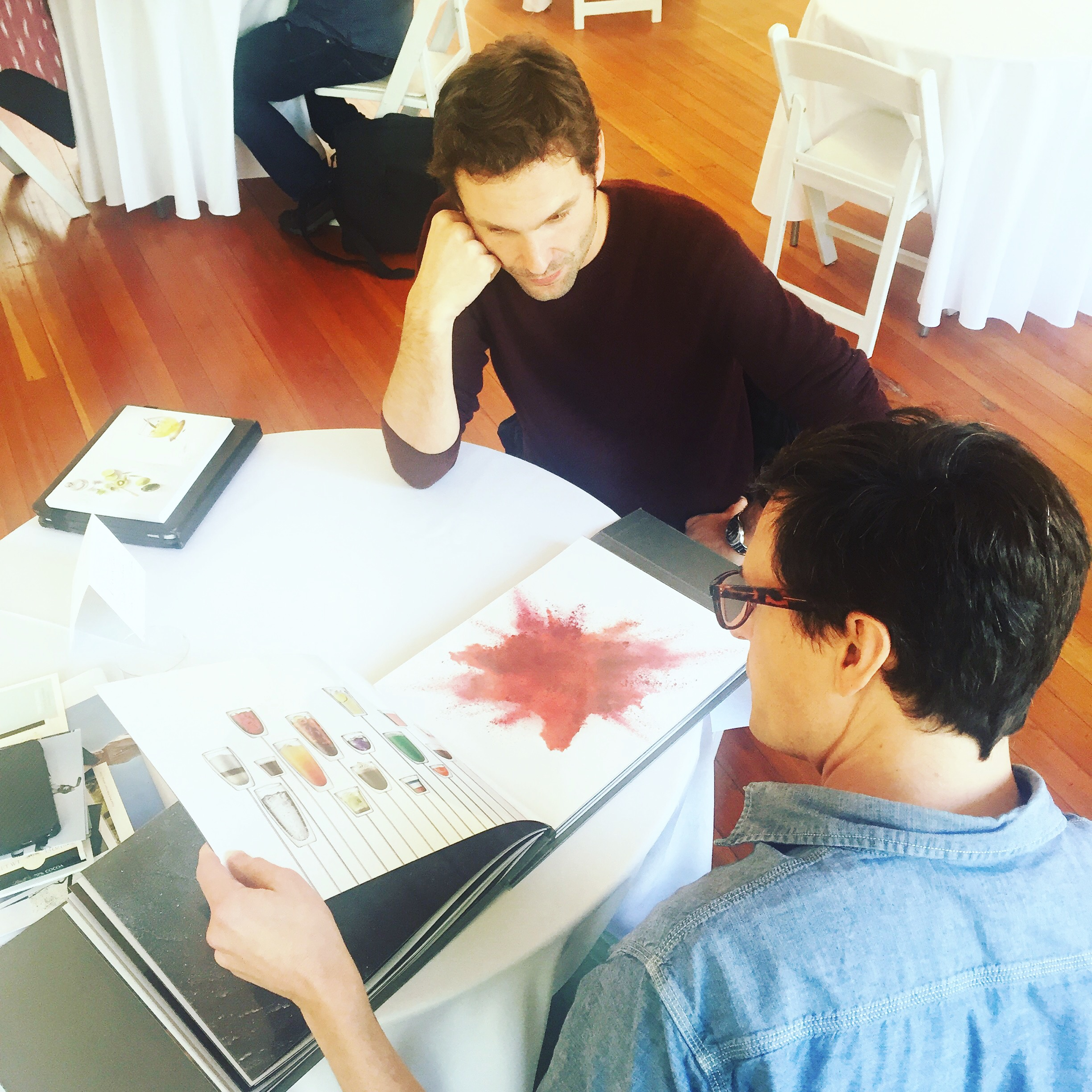 BLVDSelect member Adrian Mueller shows his work to Daniel Southwick, Director of Art & Print Production for Eleven Inc.
