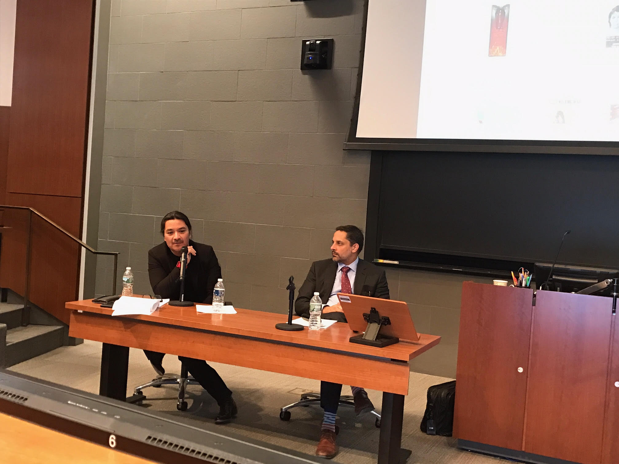 Dean of Cornell Law School and Professor of Law, Eduardo Peñalver (right) and Sergio Munoz Sarmiento discussing property law, disobedience and contemporary art at the Felix Gonzalez-Torres Symposium, which was held on March 18, 2017 at Cornell Law School.