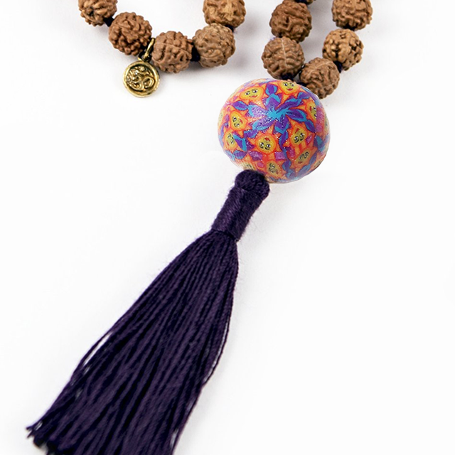 This is to color and design of the Talisman Bead- you choose the tassel color!