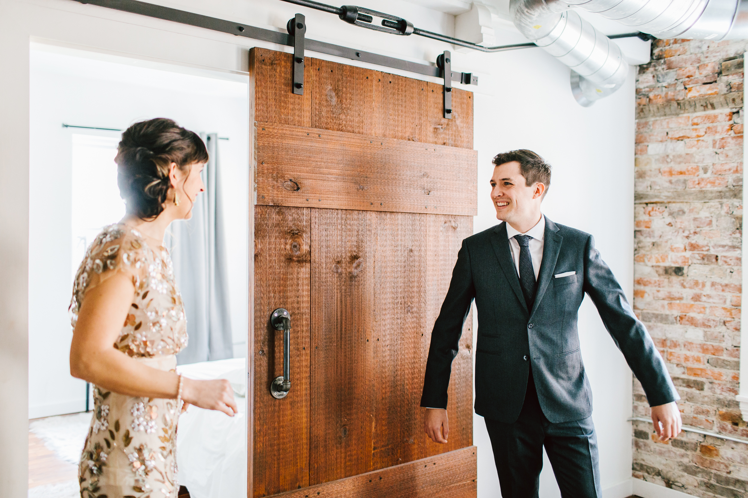 Rory in his  Indochino  suit admiring Grace in her  BHLDN  dress.