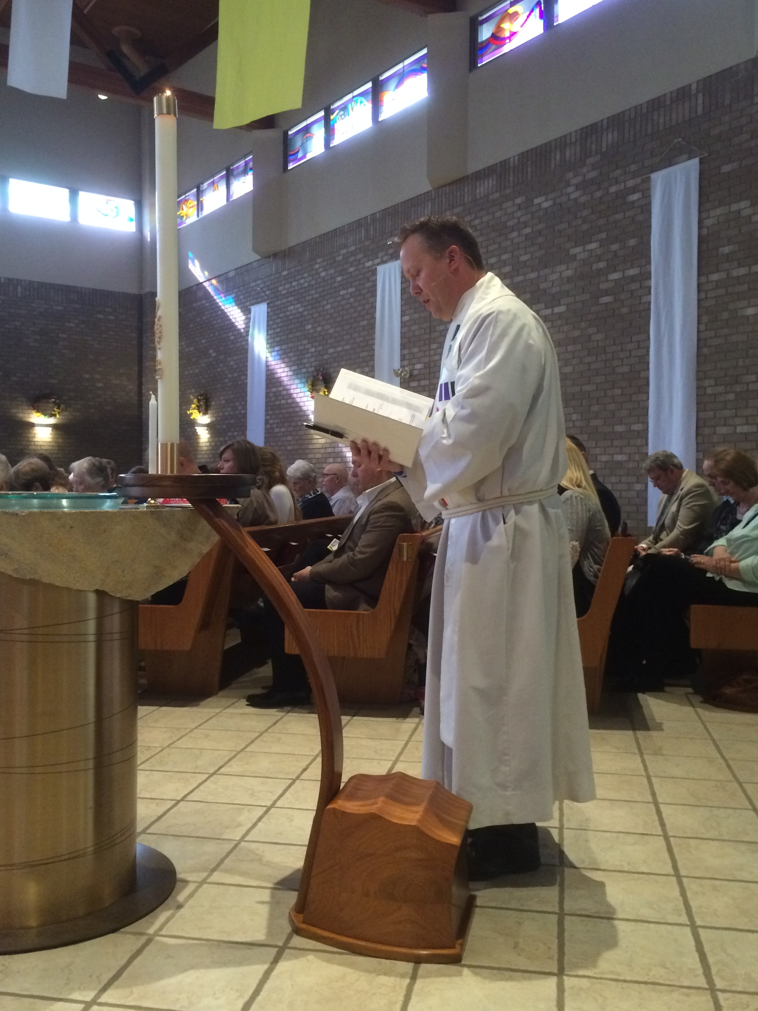 Pastor Jay dedicating the new Oak Knoll Lutheran Paschal Candle and Candelabrum.