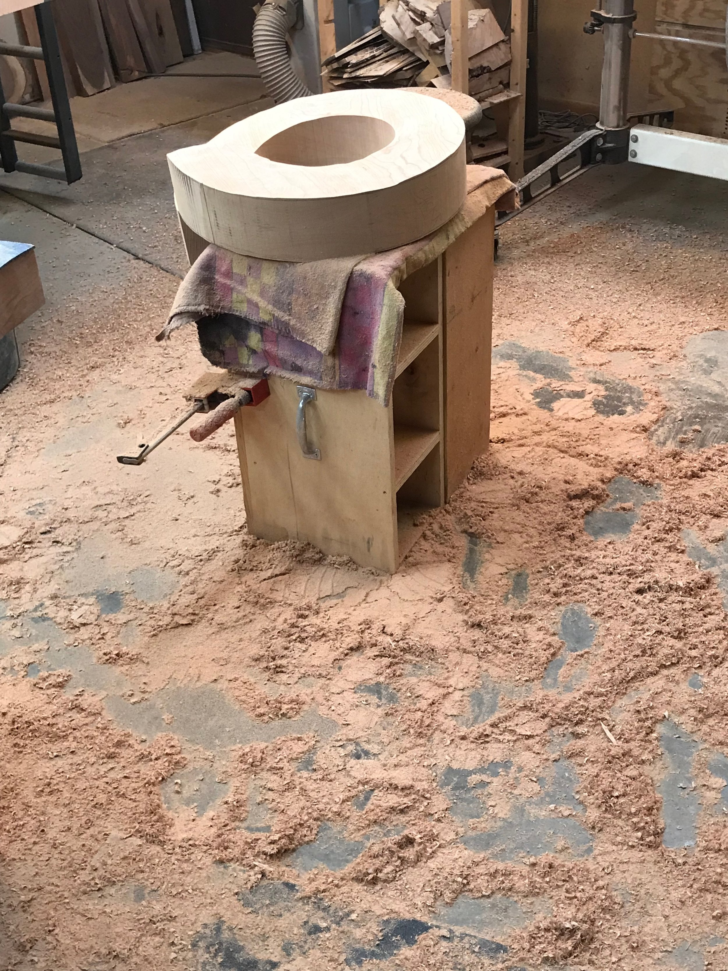 """This image shows the piece being '""""roughed out."""" As one can see, the amount of sawdust is dramatic!"""