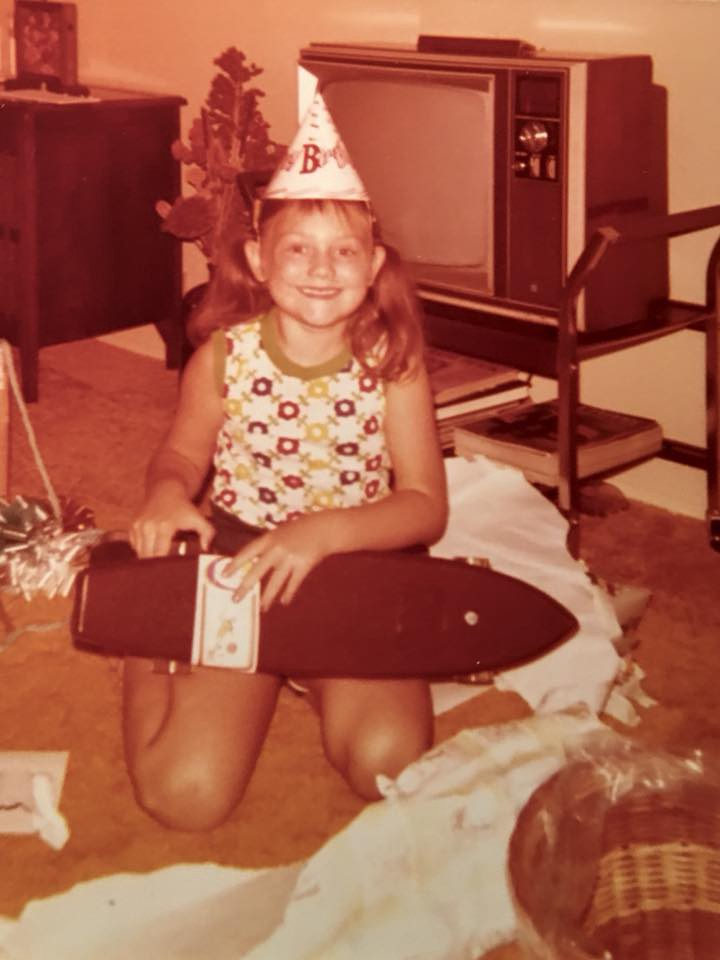 Me, birthday girl, pigtails, 70's Free Former Skateboard. Photo Credit:Mom