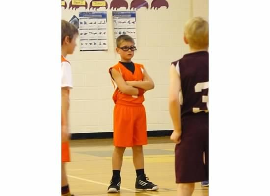 E standing at basketball.jpeg