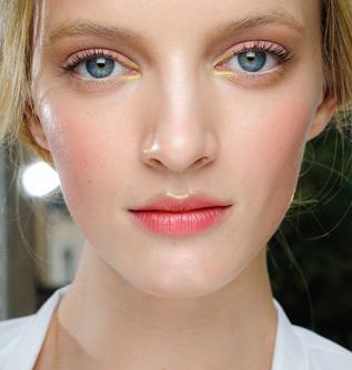 Highlight the cupid bow and inner eyes.