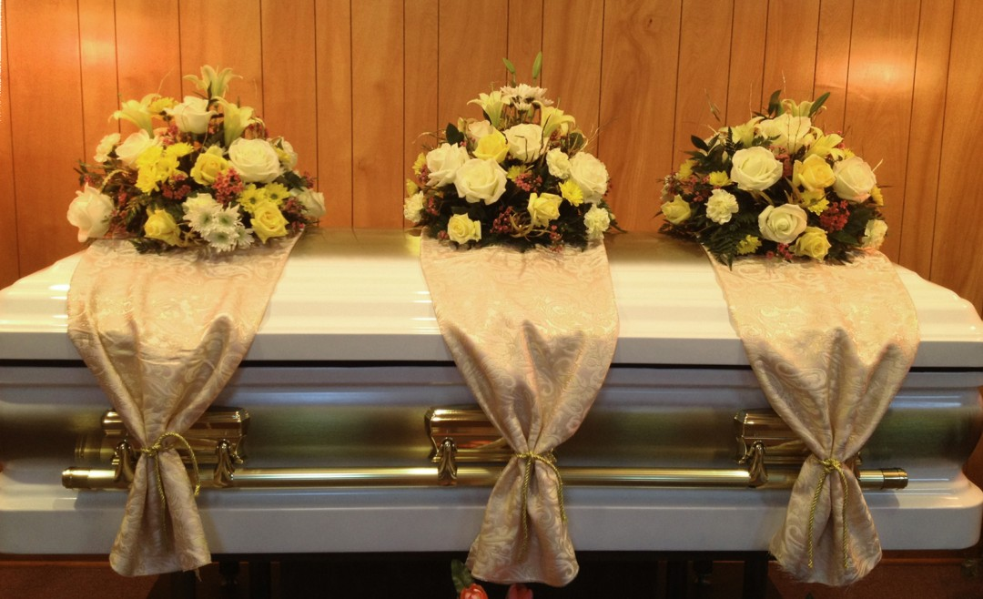 triple-casket-arrangements-with-draping-449.jpg