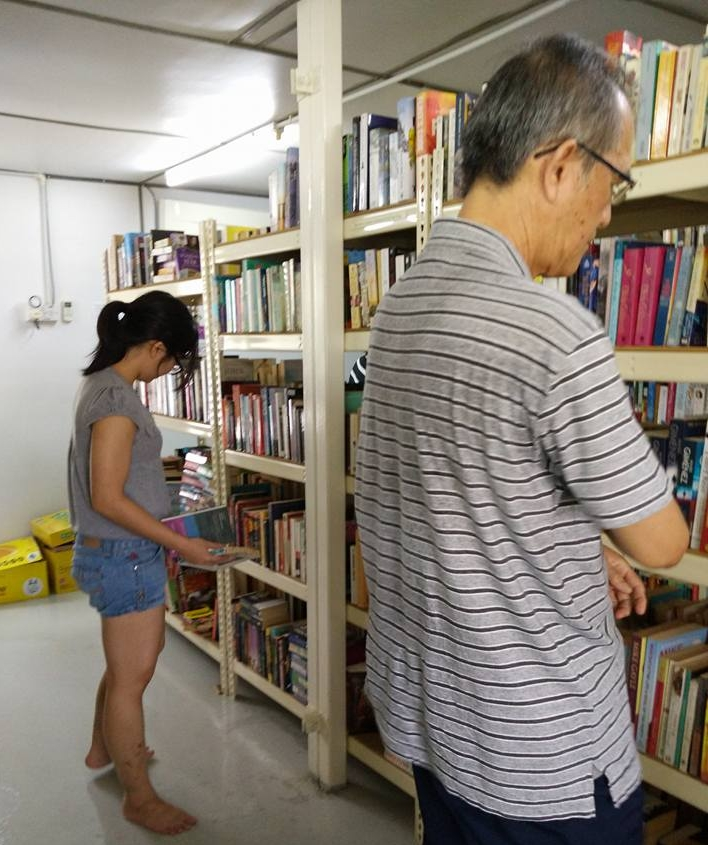 Patrons choosing their books.