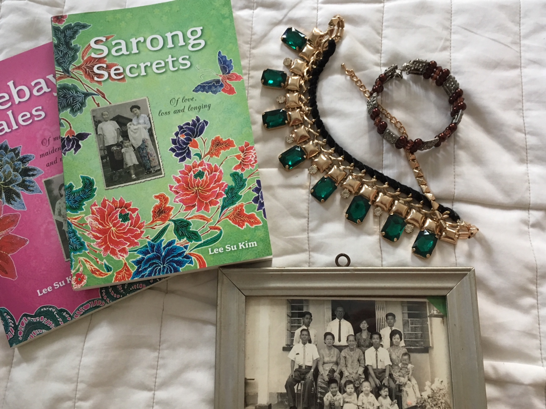 "Yes, that photo is ye olde photo of my grandmother and her family. Note the women's outfits - they are called ""kebaya""; a sheer shirt is worn over a sarong."