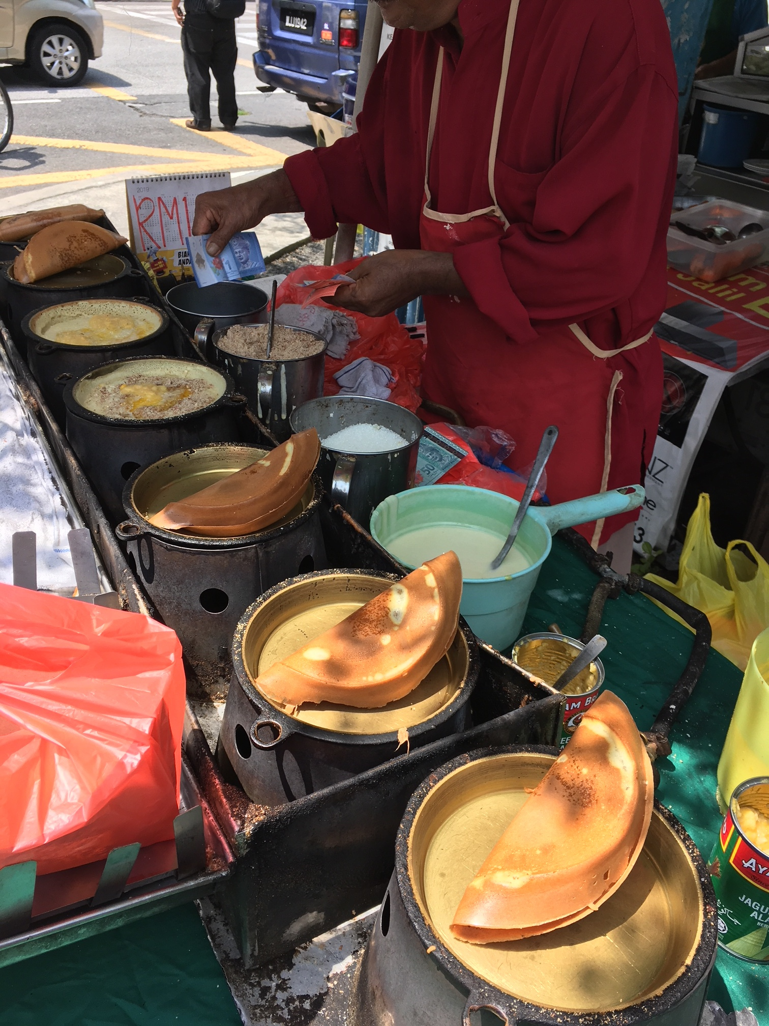 This pakcik (uncle) makes the best apom balik I've tasted. You can find him at the Subang Jaya LRT most days.