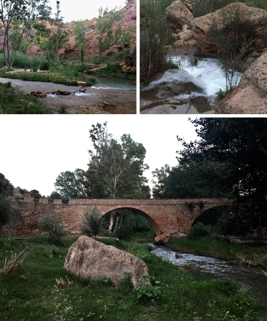 The Medieval Bridge spans a lush rock strewn valley with bamboo, reeds and willow herb.