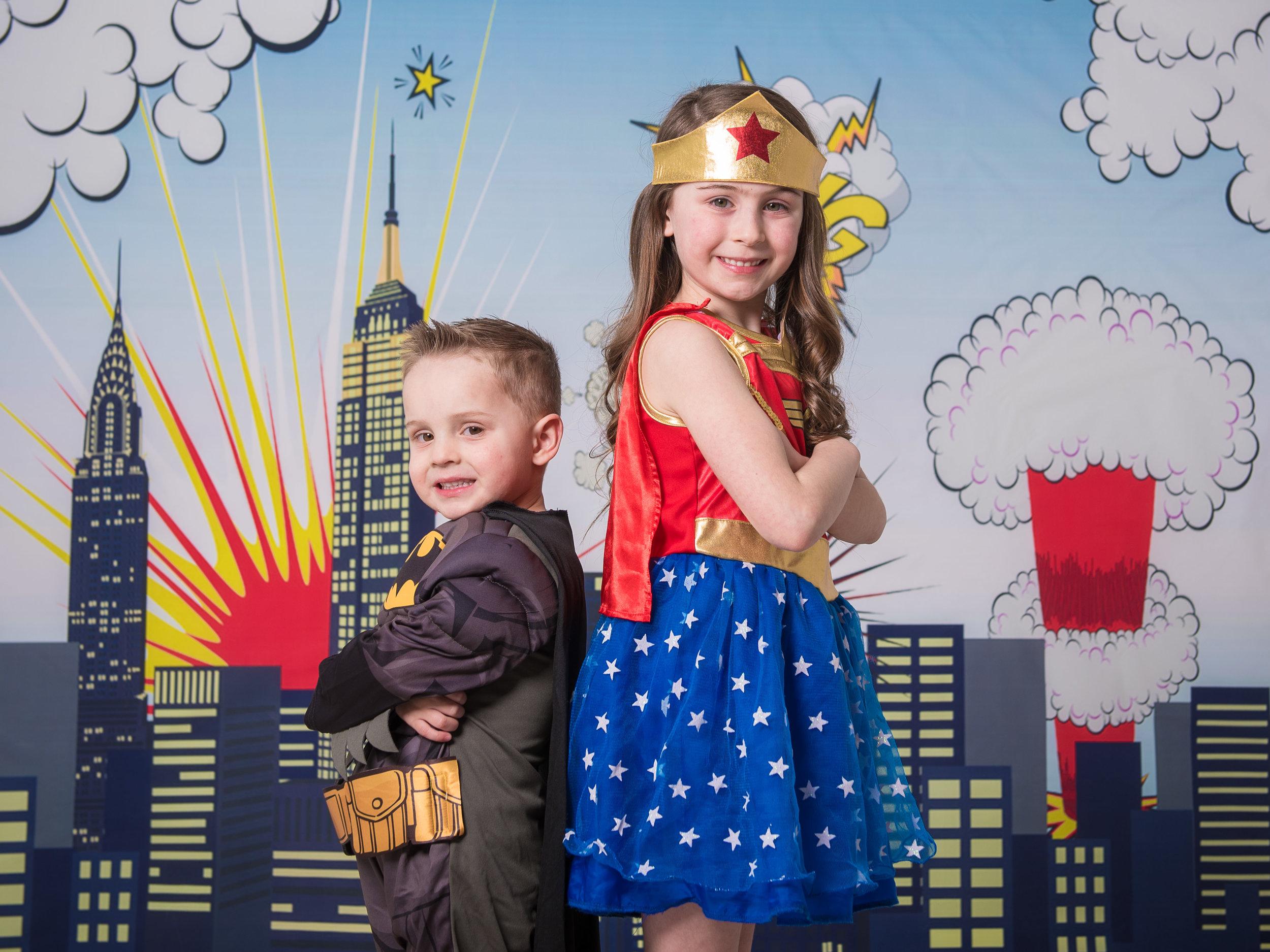 Brother & sister dressed up as superheroes Batman & wonder woman