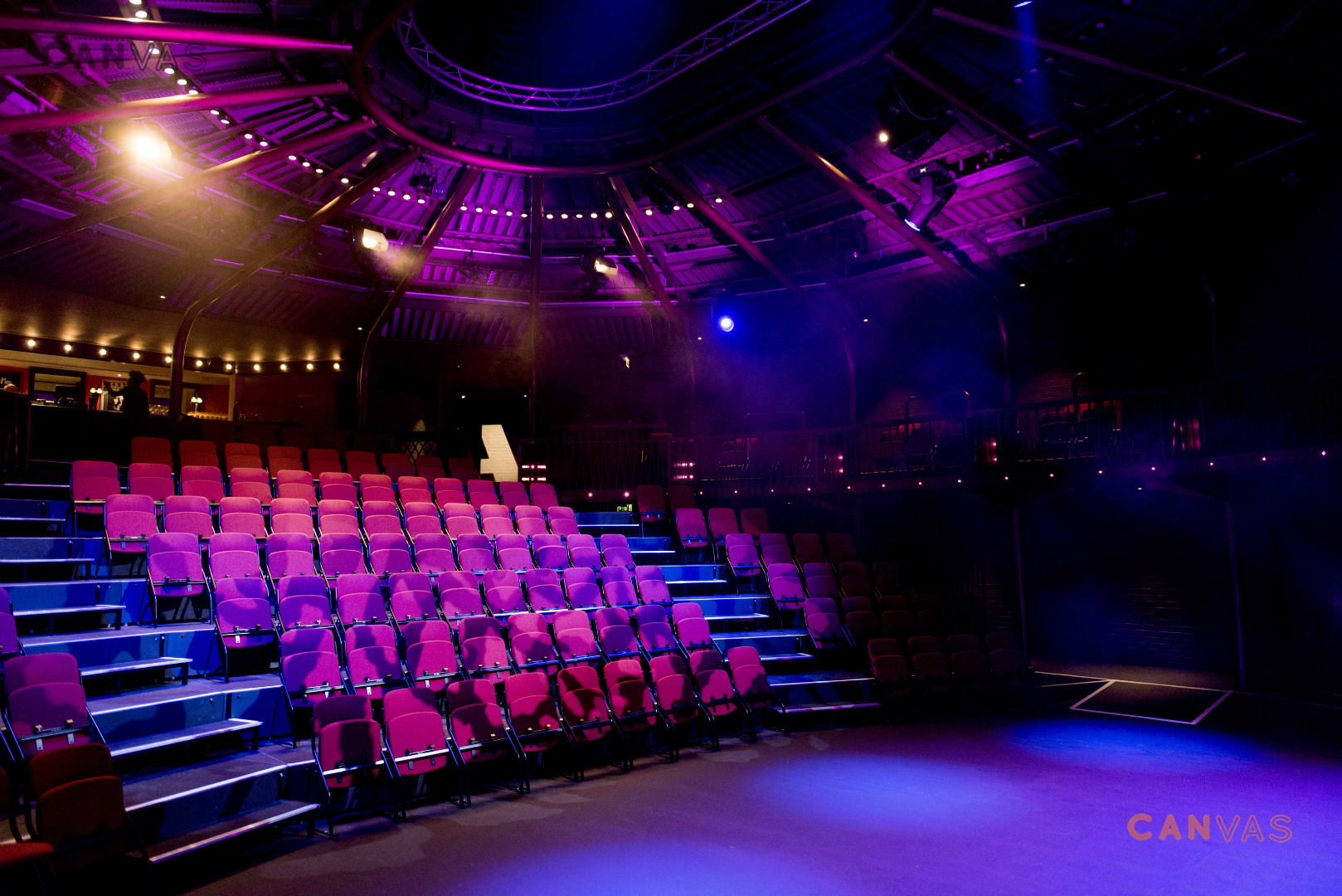 Image shows the main theatre space with tiered seating and a well-sit stage.  Source: Canvas Events
