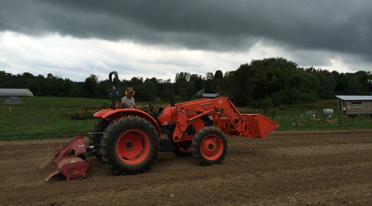 Operating the roto-tiller (on last year's super dry soil!)