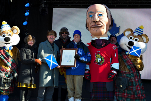 The opening ceremonies at the 2015 Winterlude kilt skate.  Joining Sir John A. and the ice hogs are Heather Theoret, Kevin MacLeod, John Ivison, Mayor Jim Watson, and Bobby Watts.