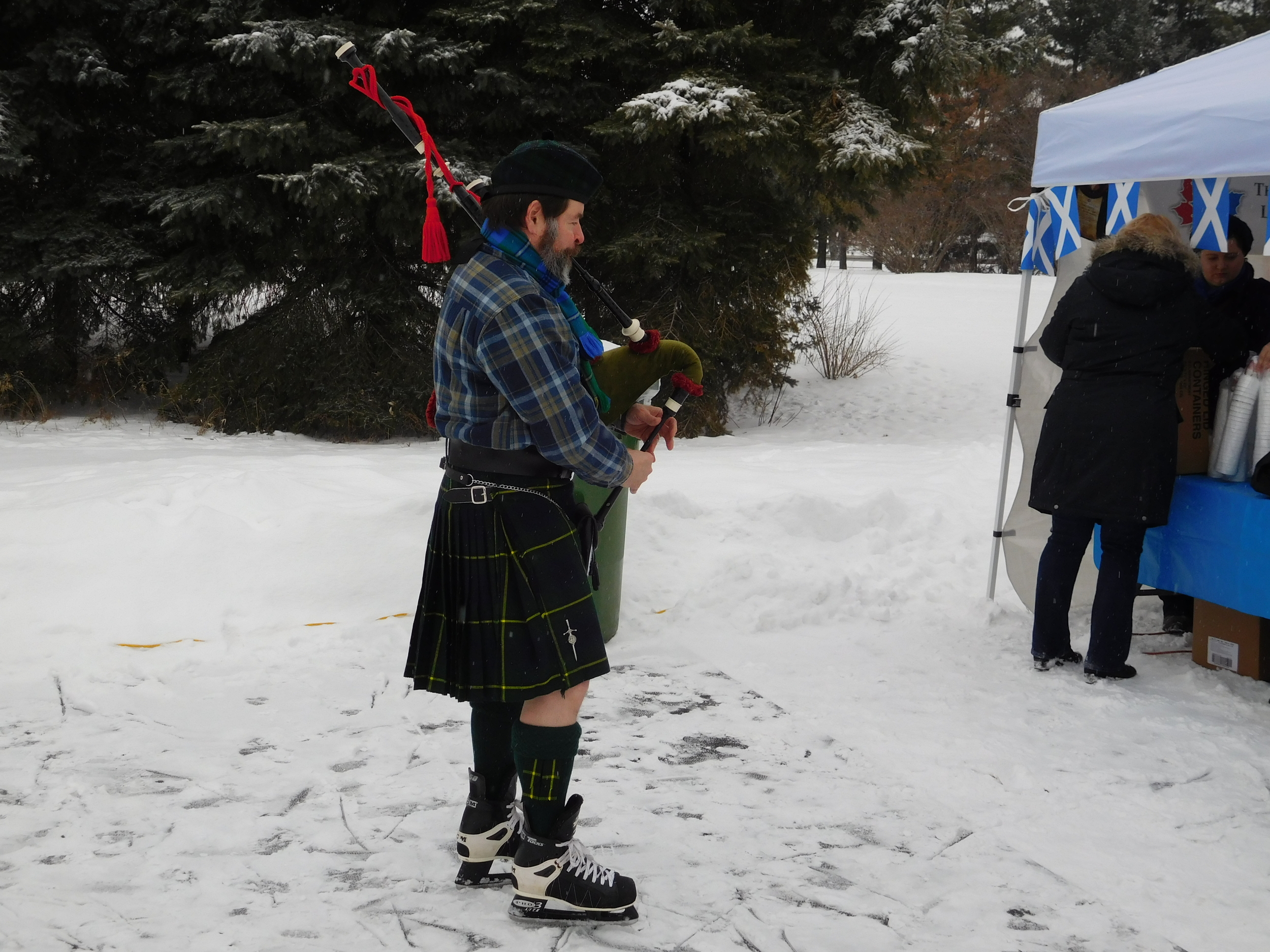 The piper warms up his pipes.