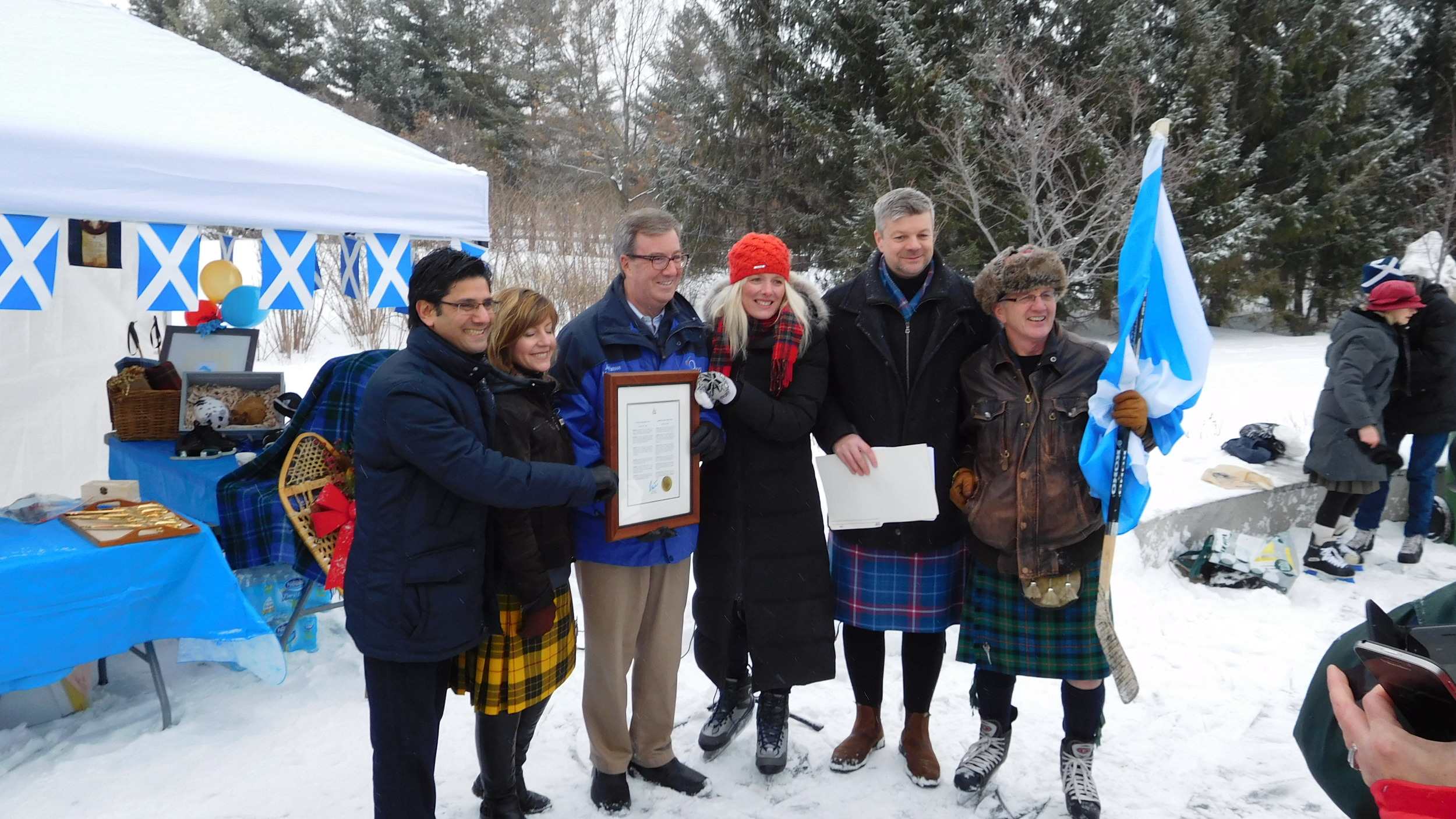 ....while the official party poses for pix. Left to right: Ottawa Centre MPP Yasir Naqvi, SSO Secretary Heather Theoret; Mayor Jim Watson; Ottawa Centre MP Catherine McKenna; SSO Executive Director John Ivison; SSO Skater-in-Chief Don Cummer.
