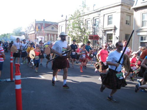 As if running in 30 degree heat wearing a woolen kilt isn't enough, some runners do it carrying Highland weaponry.