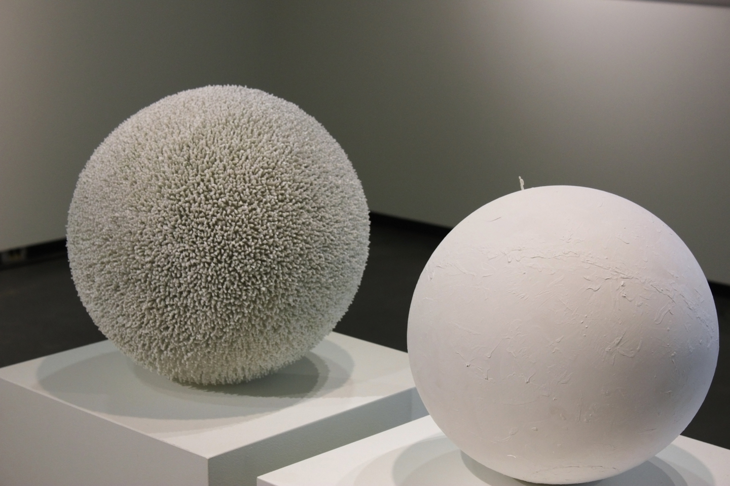 Private and Public Lonerism - Plastic Human Figures on Primed Spheres