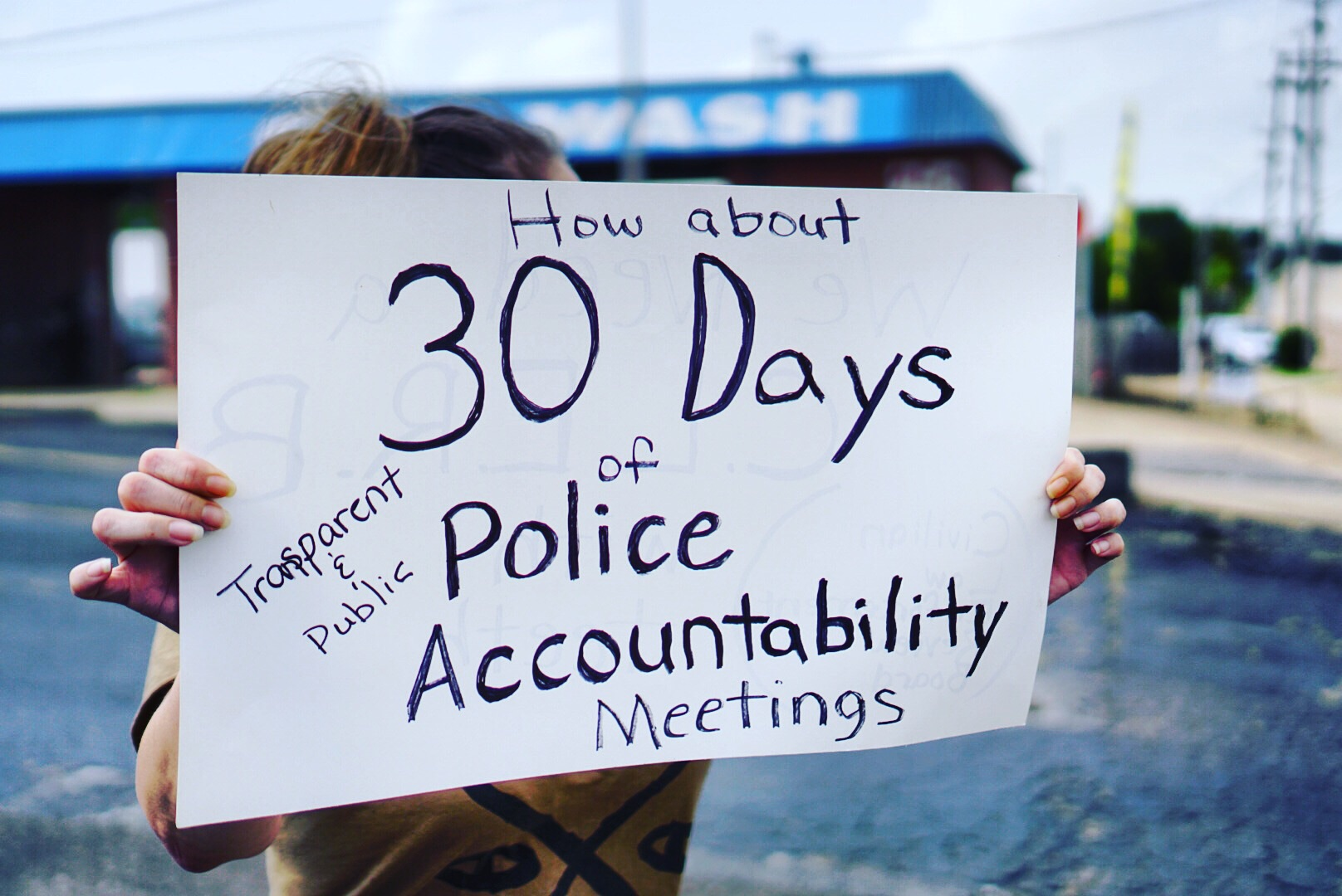 Protestor outside townhall meeting