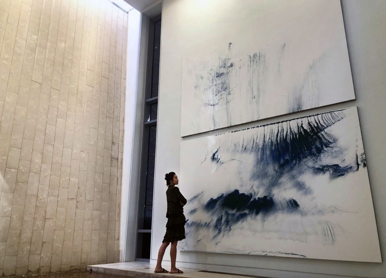 Kate Shin, in front of Makoto Fujimura's Walking on Water painting next to the Waterfall (2019, Waterfall M&G 2019)