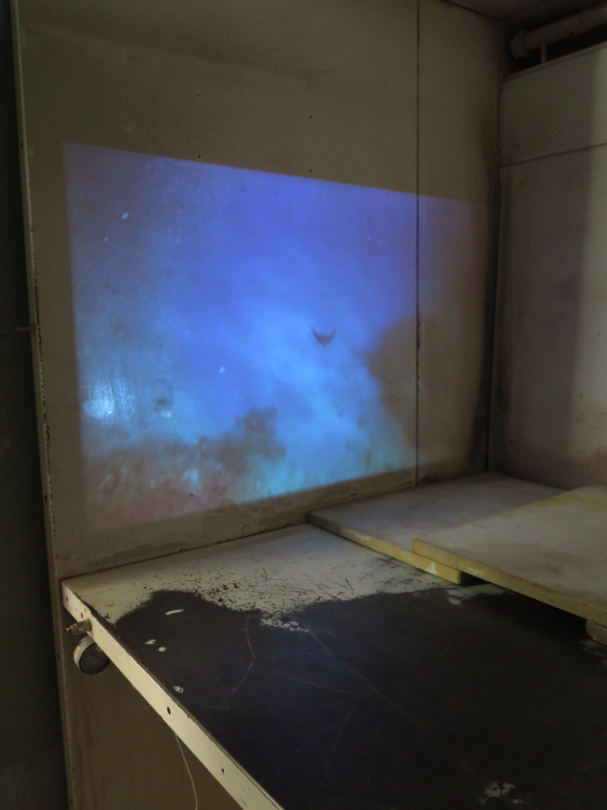 Detail of Narrow Footings video installation in spray booth, 2017