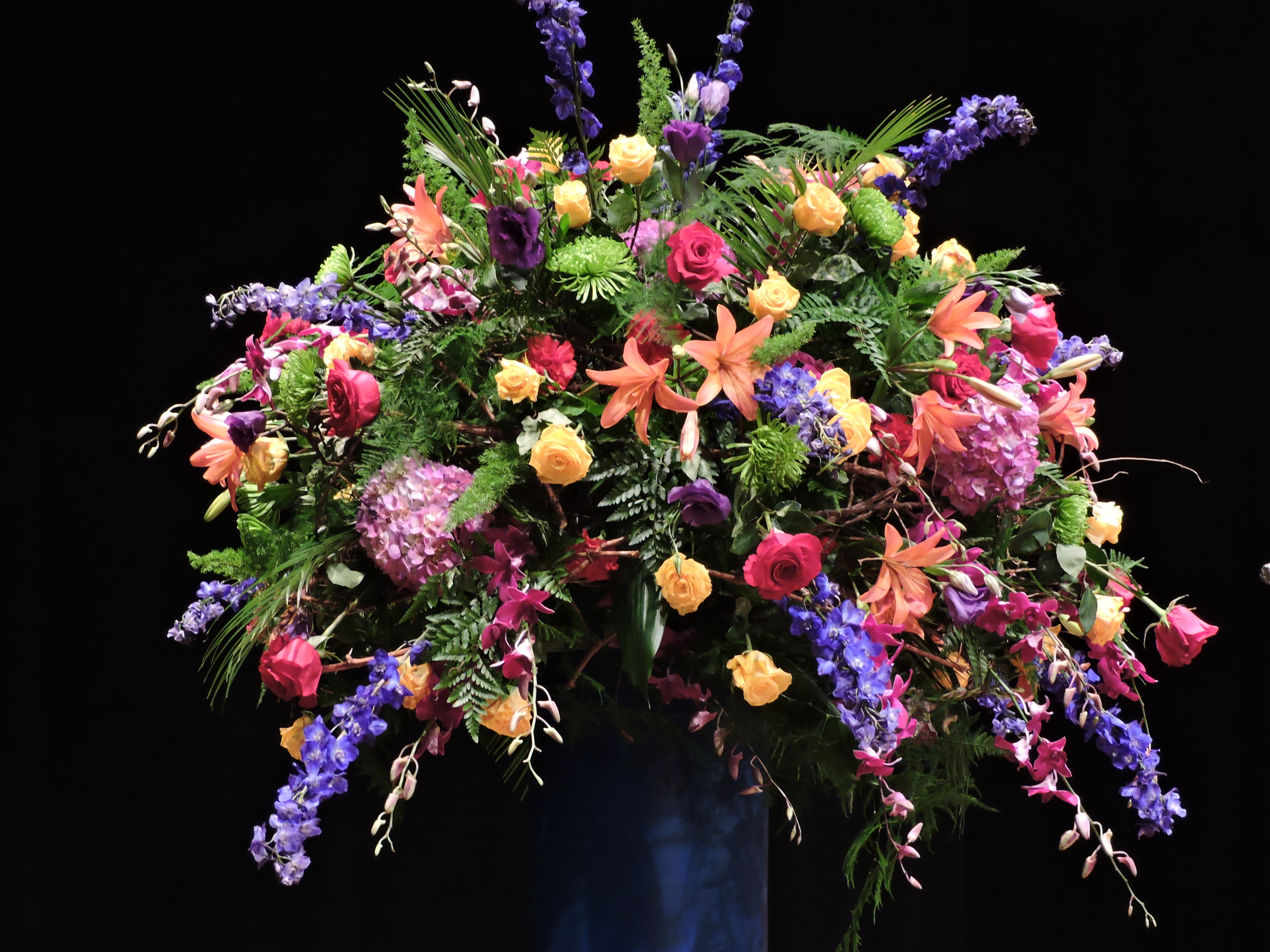 Luscious blooms in brilliant colors graced the stage at the Wang Center for His Holiness the Dali Lama