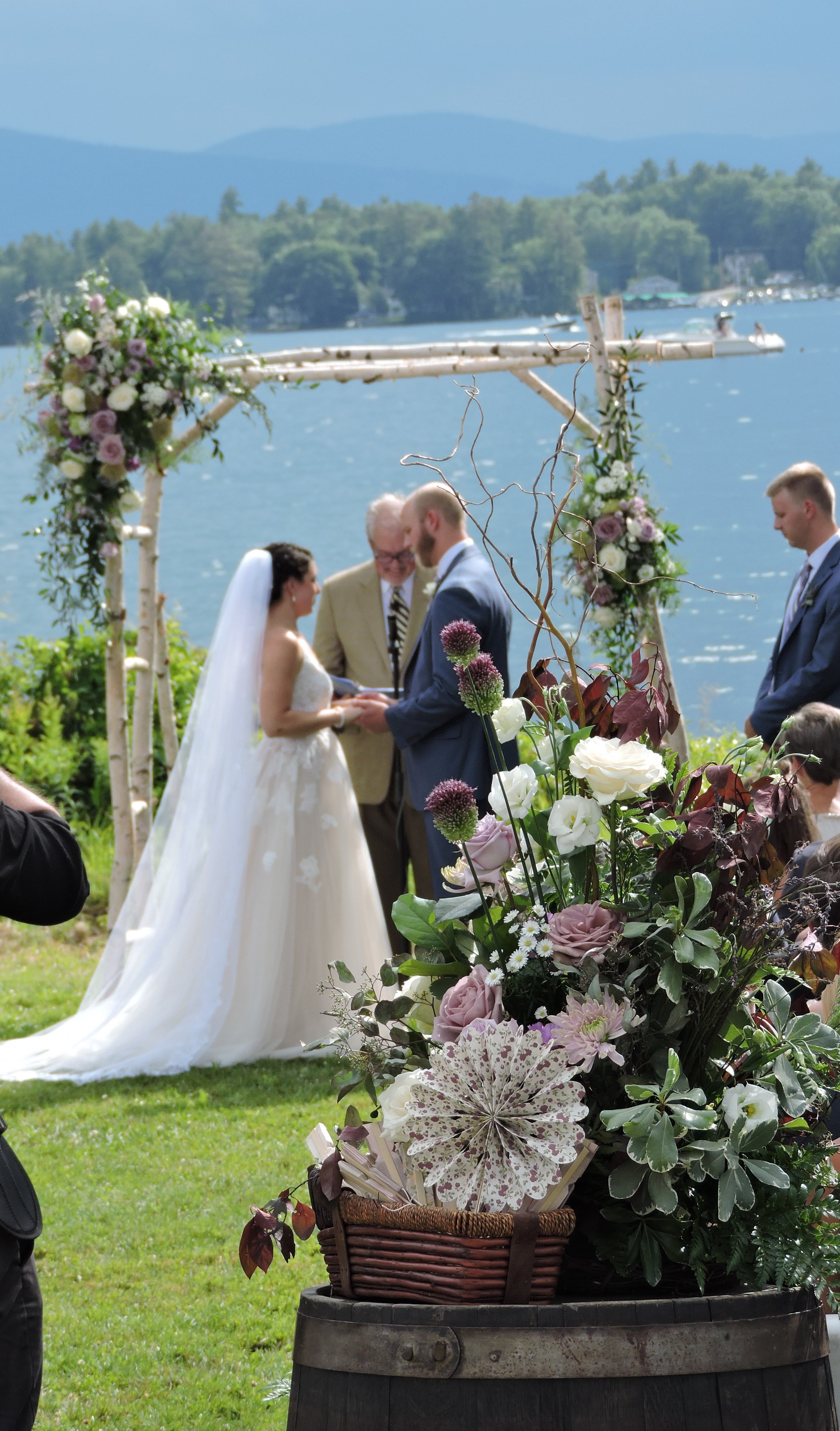 Wedding at Brewster Academy, NH with birch arbor on Lake Winnipesaukee