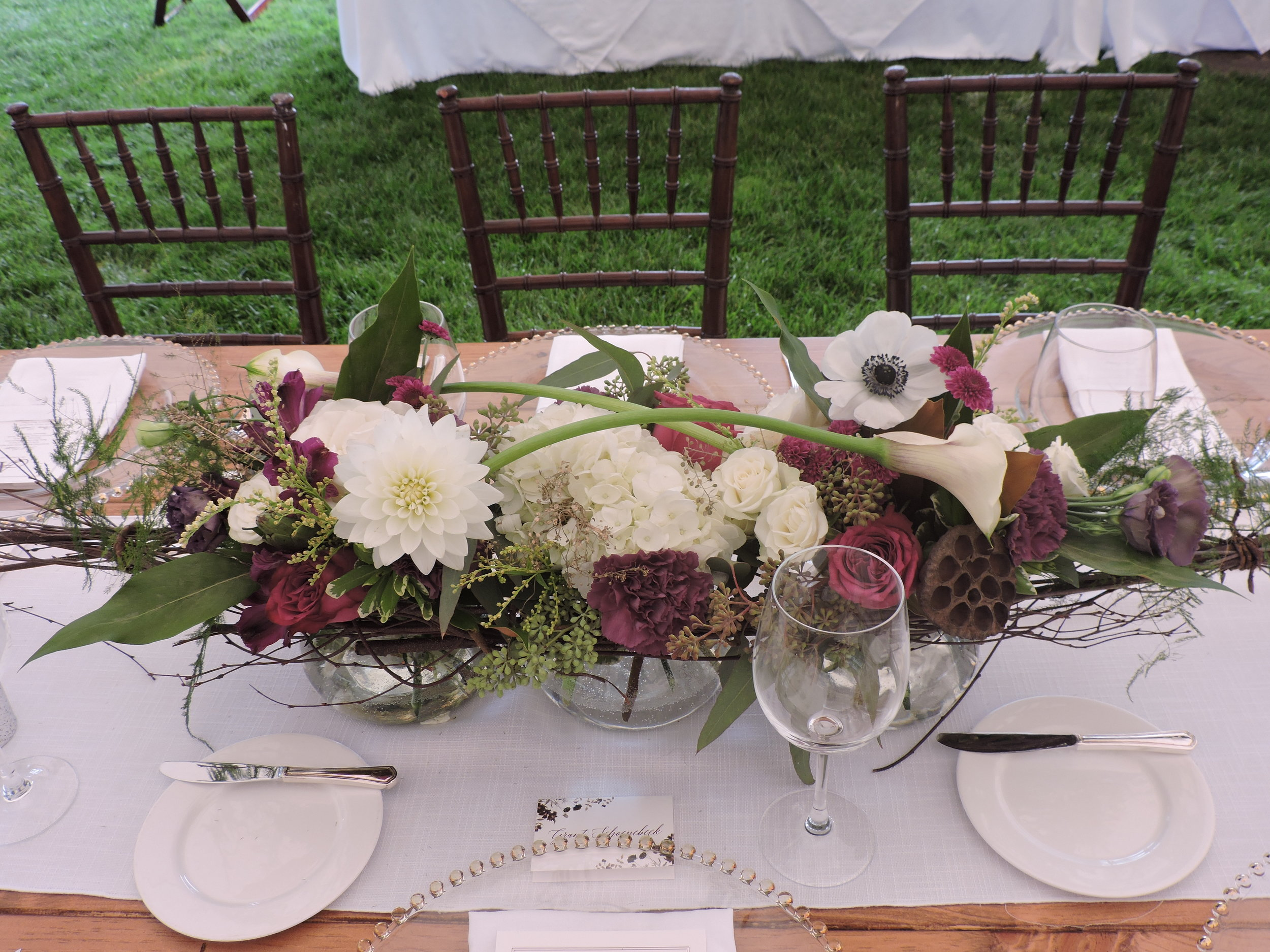 Garden roses, anemones and calla lilies in a trio of glass bowls connected with twigs on a farm table at The Country Club, Brookline, MA by Maureen Christmas AIFD CFD EMC of Floral Notes, Acton, MA