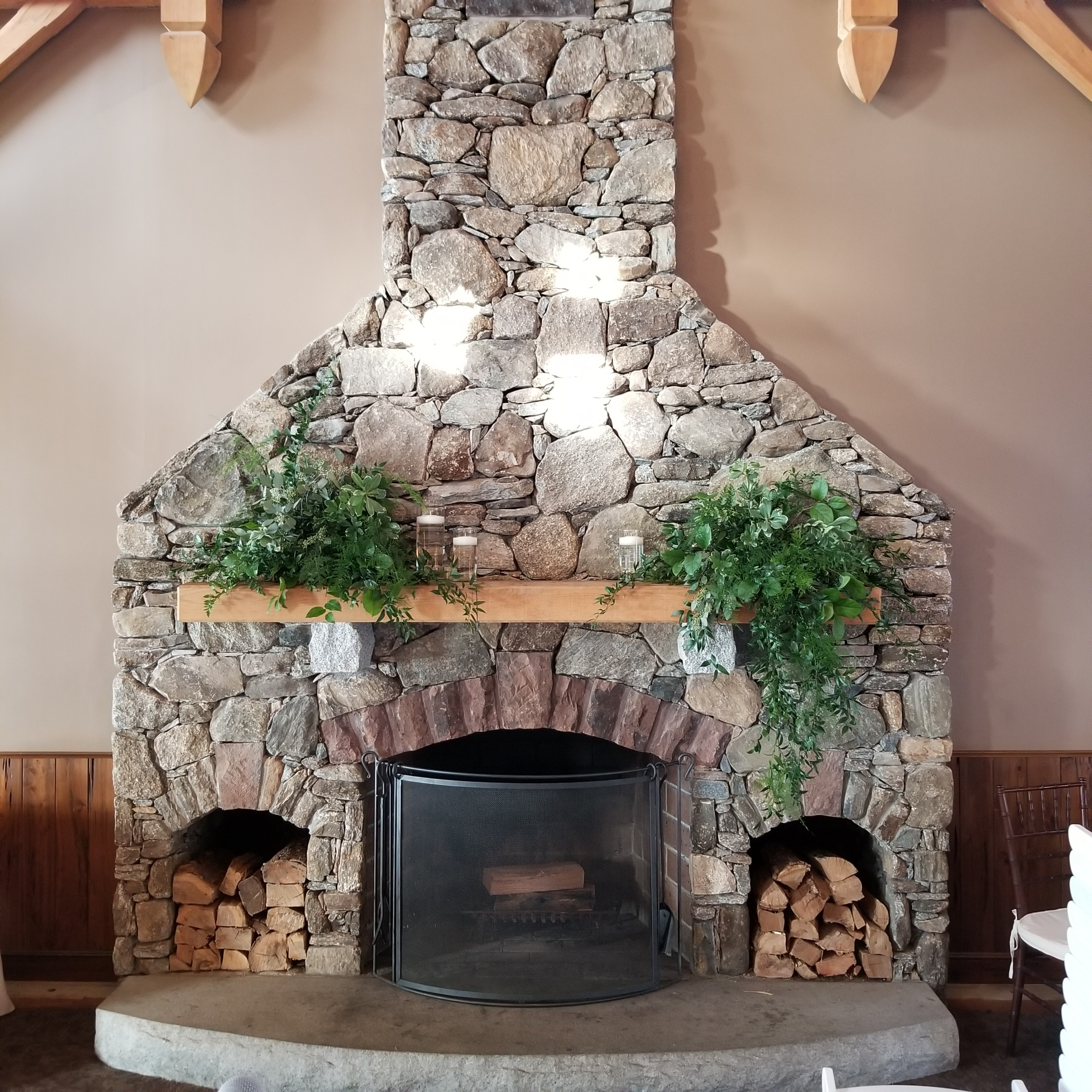 Harrington Farm Fireplace - greenery and floating candles.jpg