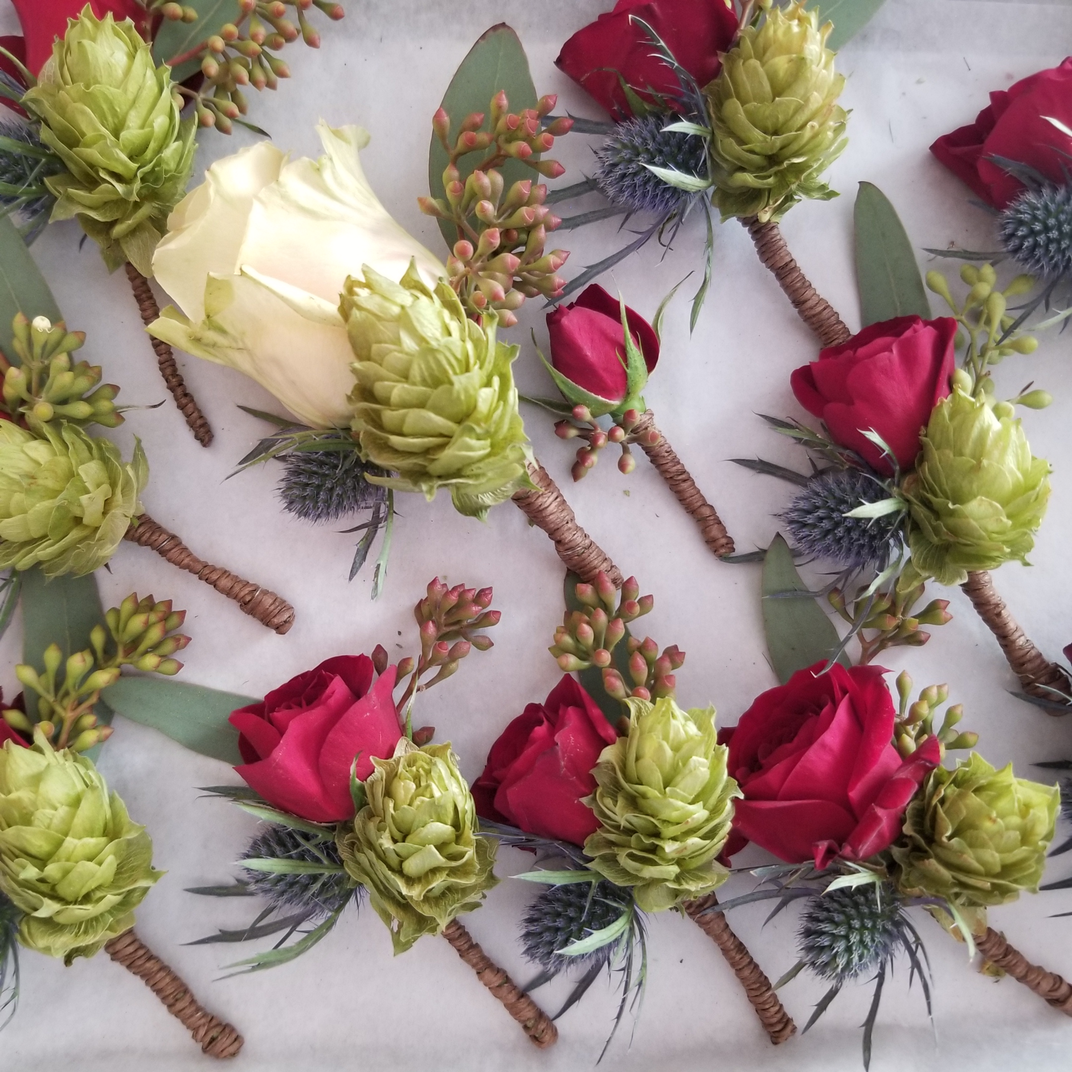 Boutonnieres with hops grown by the couple. Wedding at Harrington Farm, Princeton, MA