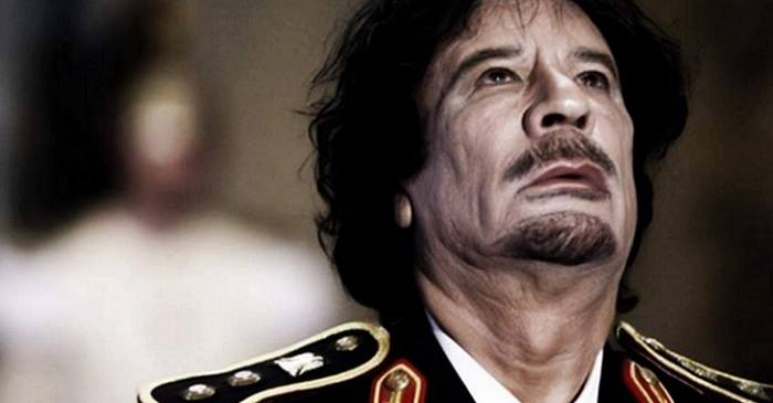"""Muammar Qaddafi. Photo taken from Carey Wedler's article, """"The Last Country We 'Liberated' From An 'Evil' Dictator is Now Openly trading Slaves"""""""