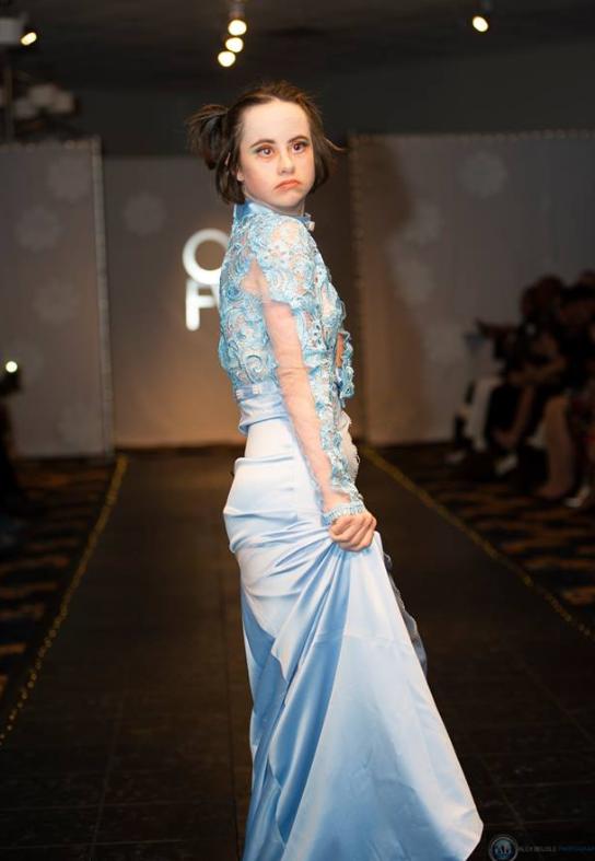 Olivia DePiore in a stunning blue dress.