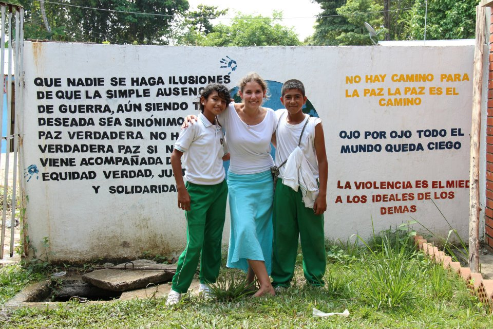 """Teaching at at the local school in the Peace Community in La India, Santander Colombia during my field research. One quote on the mural says, """"There is no path to peace, peace is the path."""""""