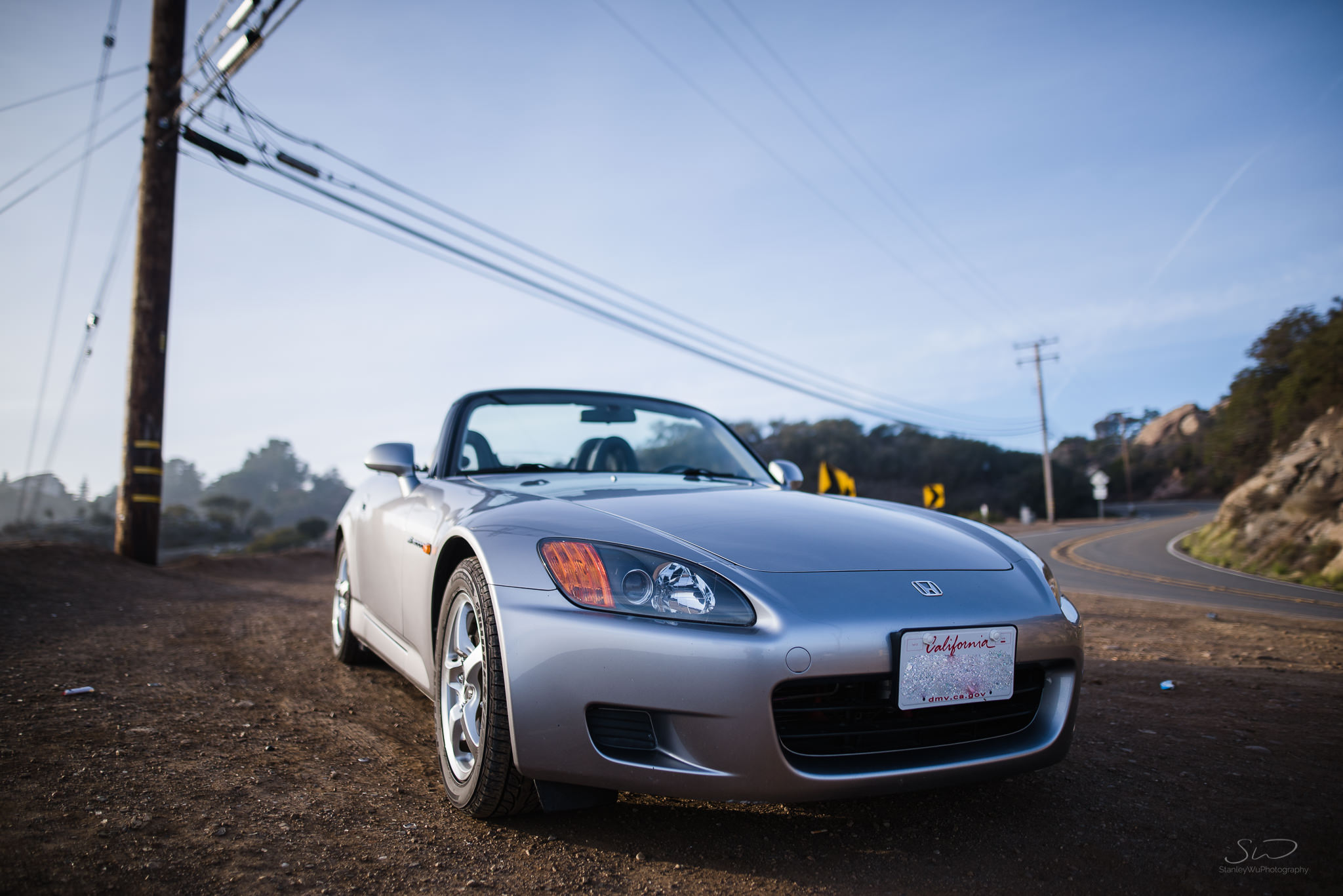 dramatic photo with a wide lens of honda s2000 in malibu sunny california