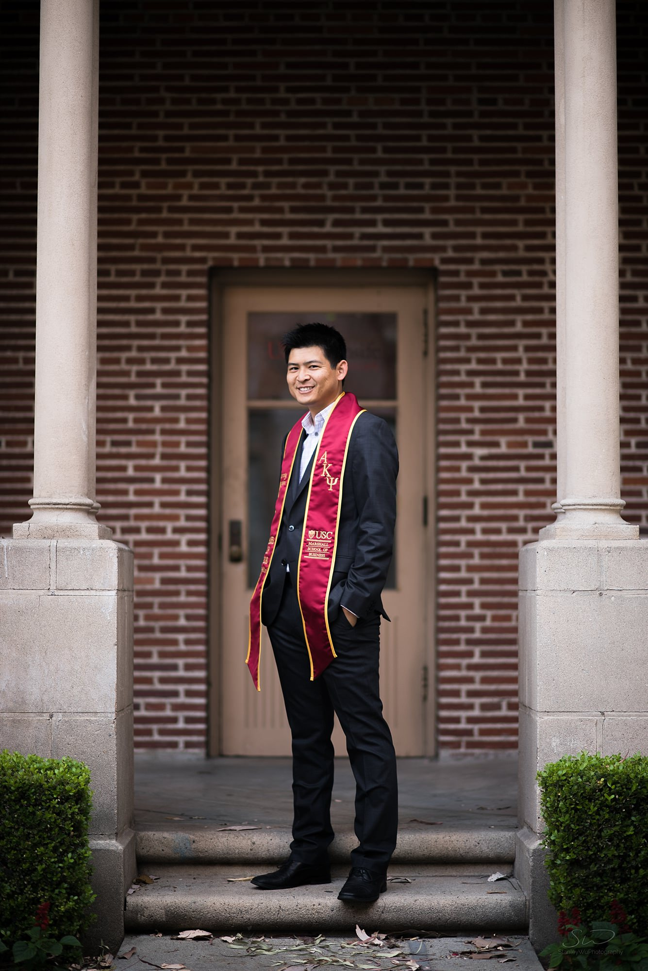 graduation senior portrait of a man smiling at usc in los angeles