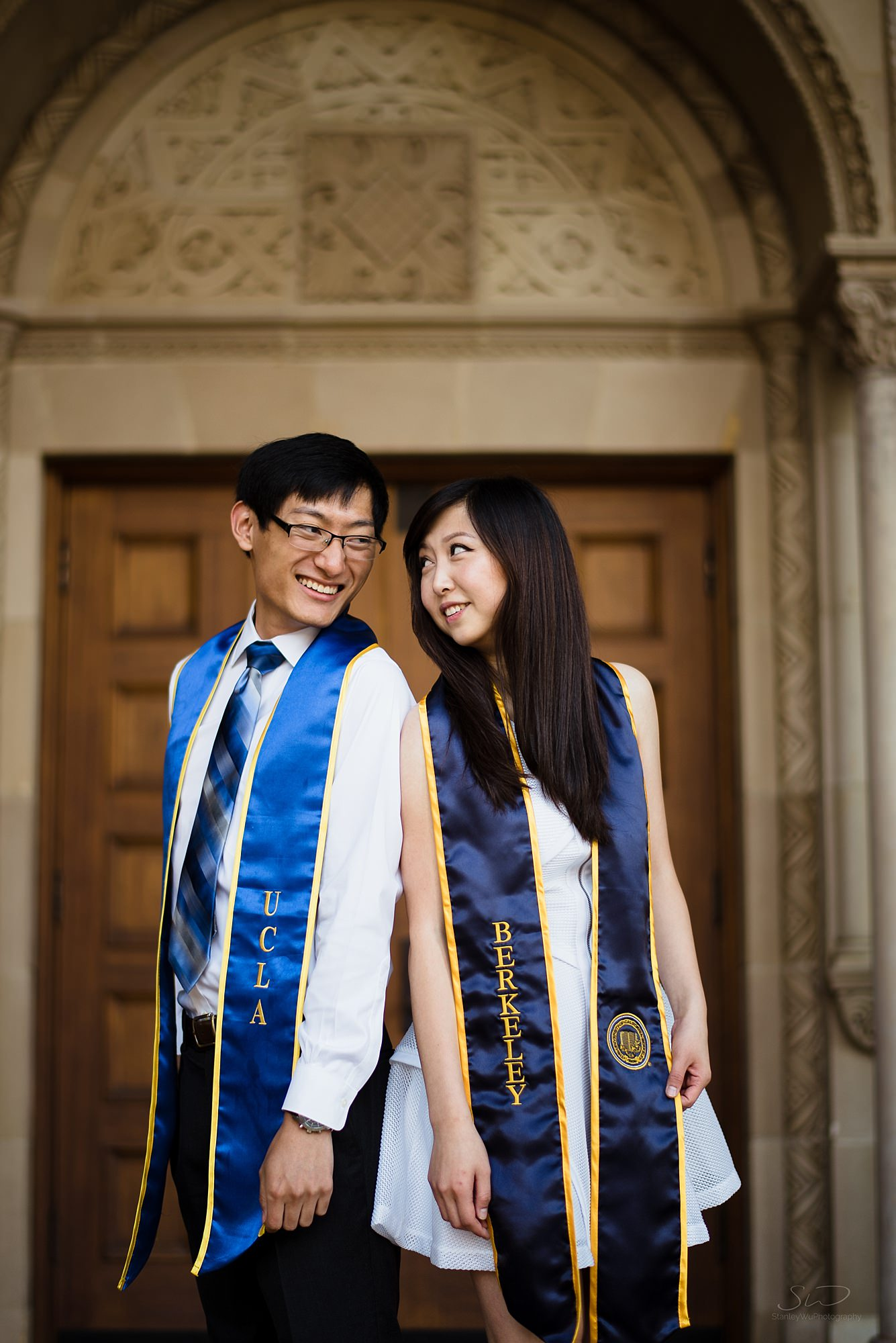 beautiful graduation senior portrait of an asian couple looking at each other at ucla in los angeles