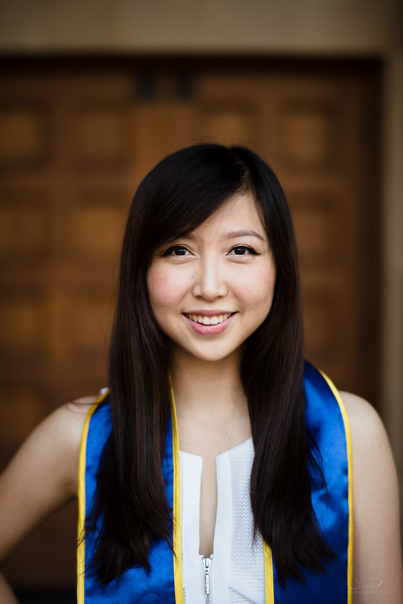 graduation senior portrait closeup of a girl smiling at ucla in los angeles