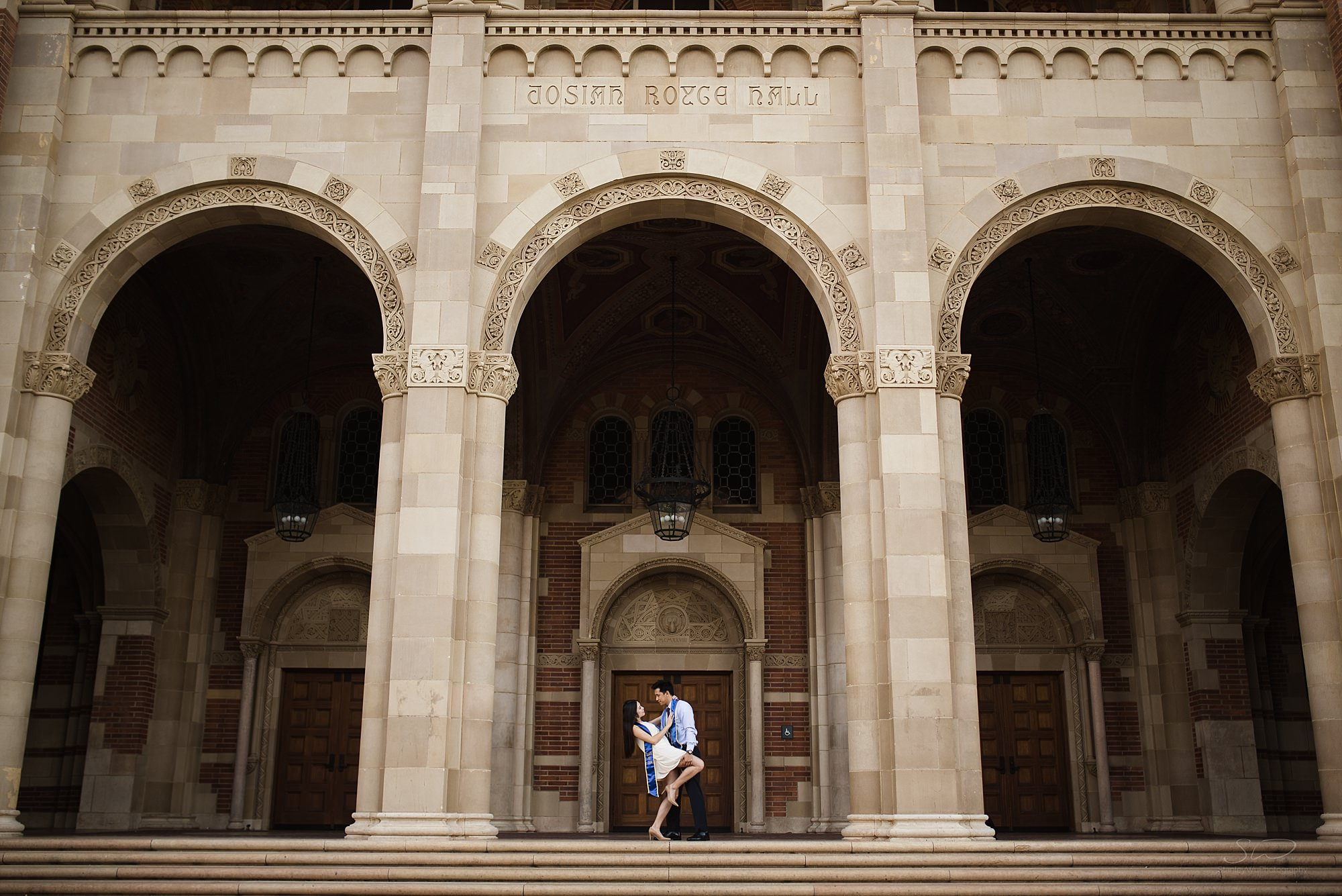 los angeles graduation senior portrait ucla epic architectural photo with couple in love kissing
