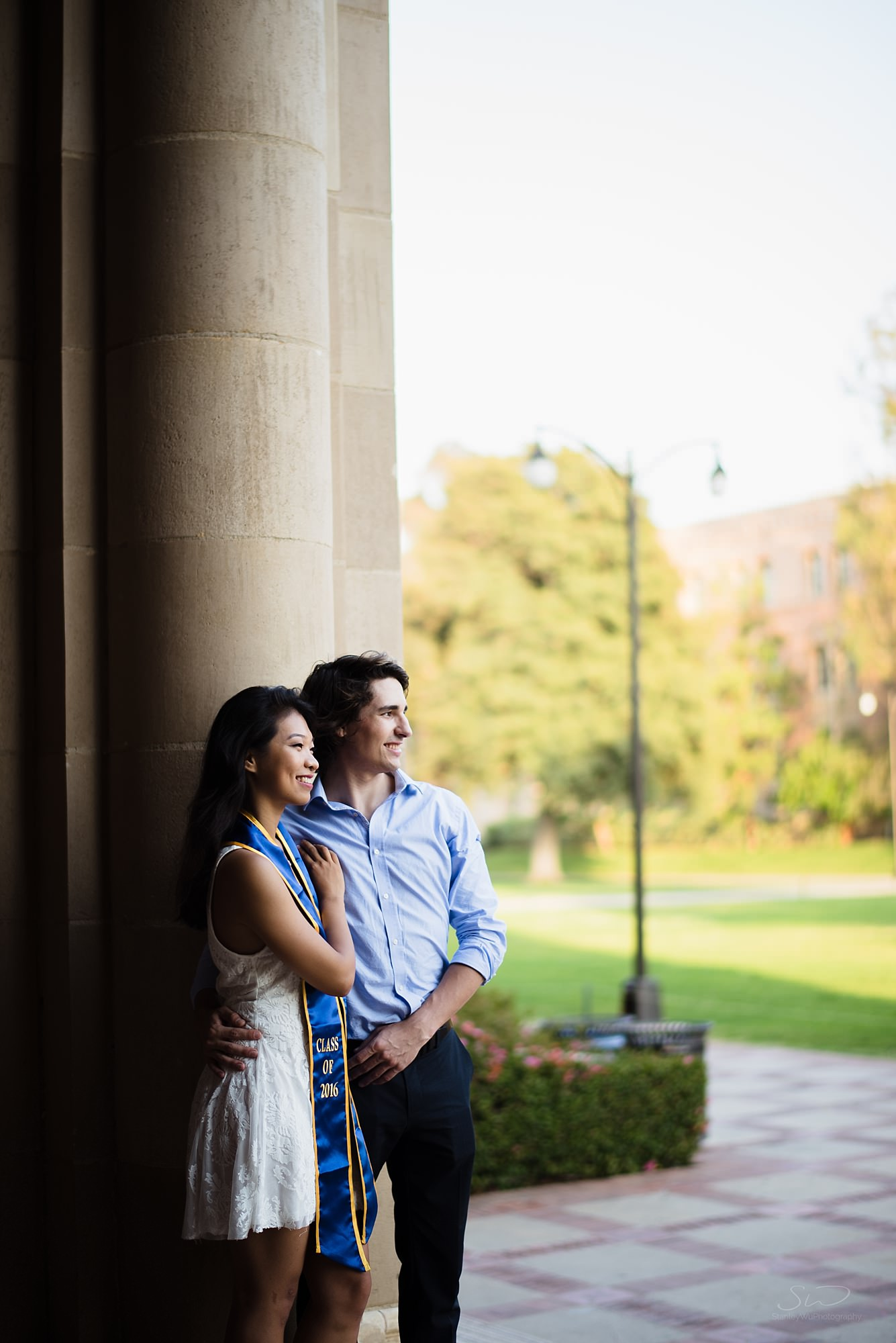 beautiful graduation senior portrait of a couple sidelit by epic light at ucla in los angeles