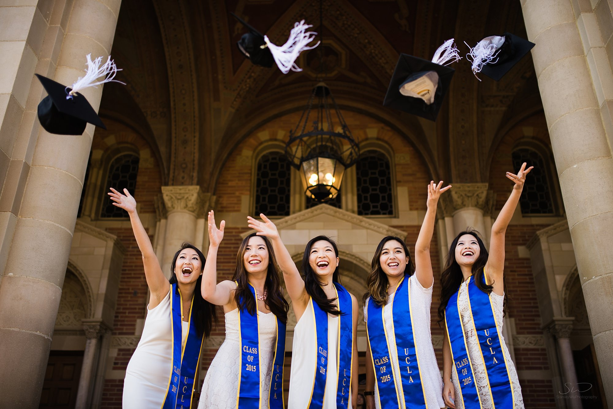 los angeles graduation senior portrait ucla akpsi girls throwing caps in the air