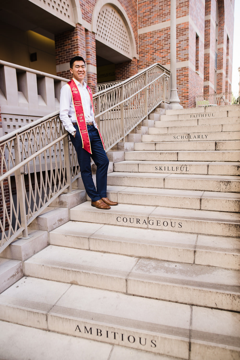 USC college senior graduate standing on steps of Troy by Stanley Wu Photography | Los Angeles Portrait & Wedding Photographer