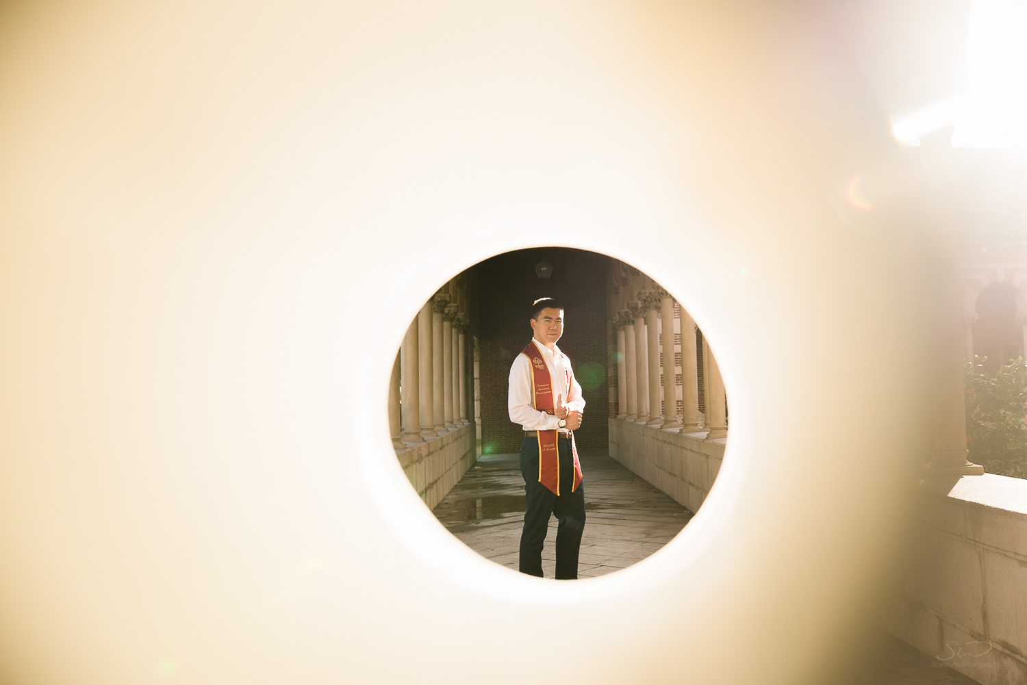 USC college senior graduate with James Bond pose by Stanley Wu Photography | Los Angeles Portrait & Wedding Photographer